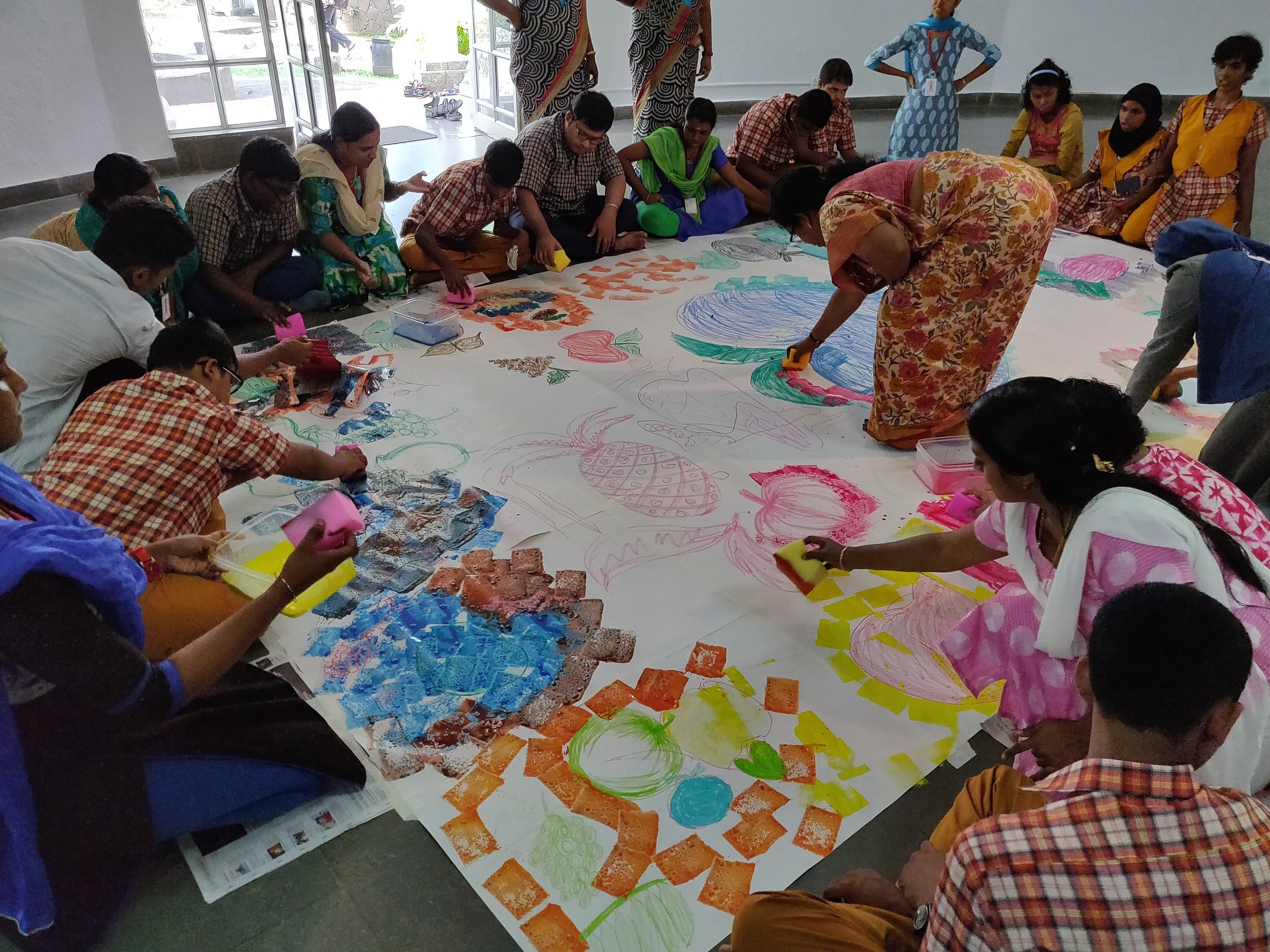 A sponge painting session for students, teachers and teacher trainees at the Visual Arts Centre.
