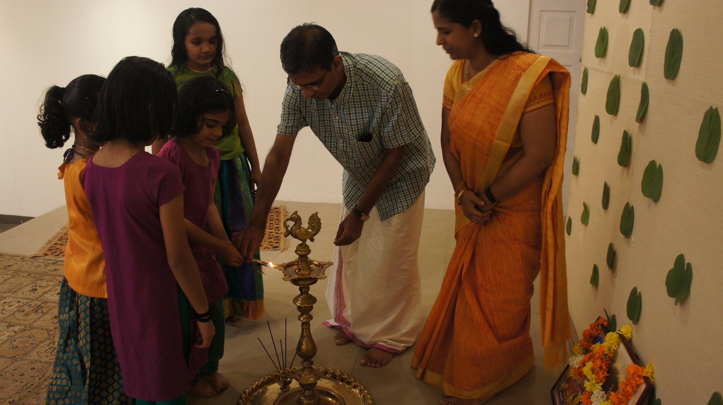 Lighting the lamp with Shri K Rajesh, our Carnatic music teacher