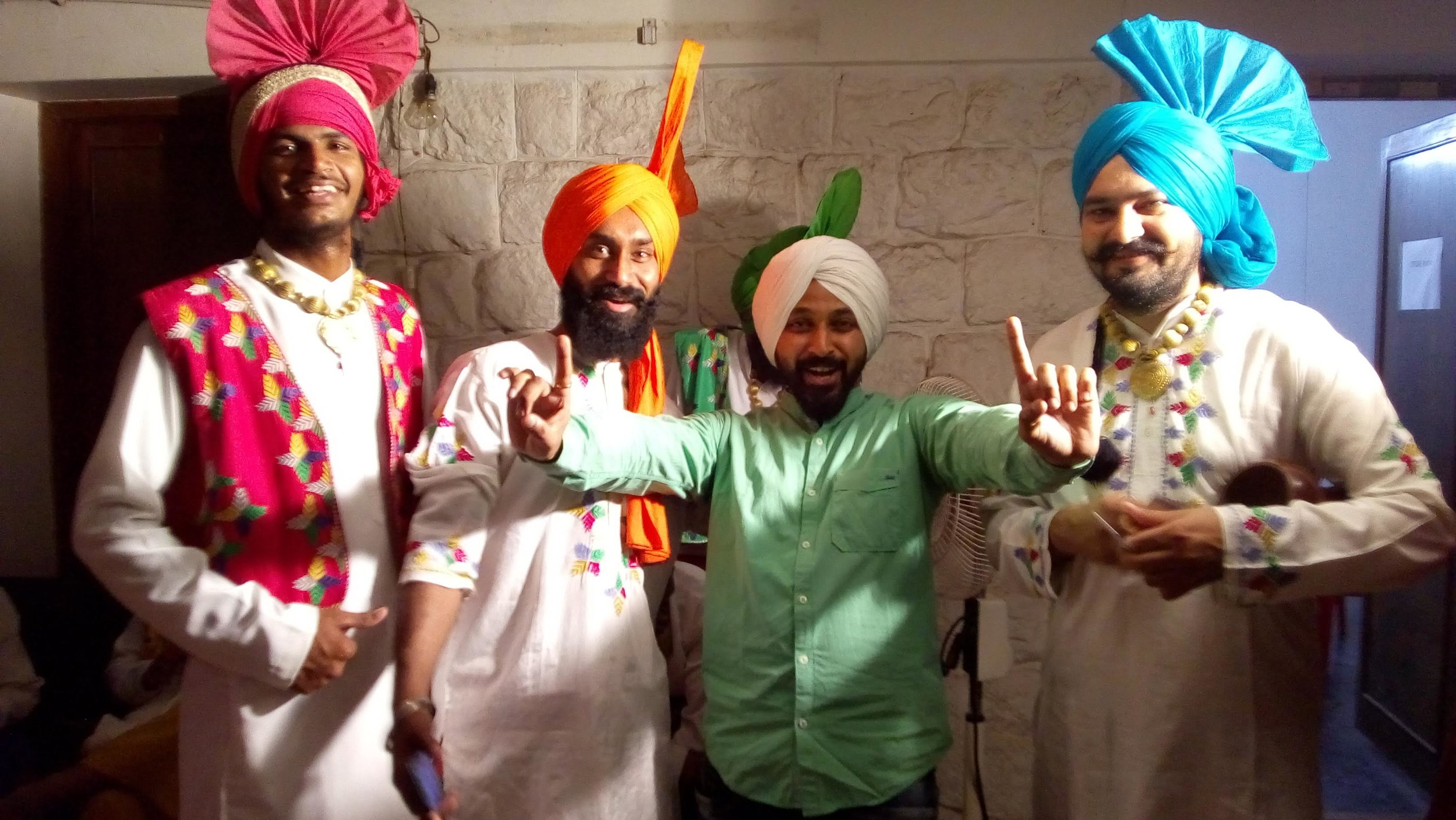 RJ Karthik posing with the Bhangra dancers