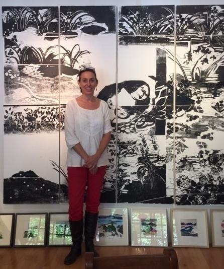 Julie with her mural.jpg