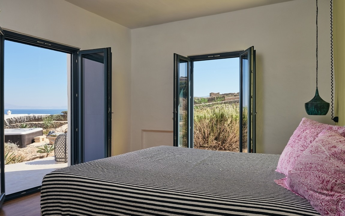 Oceanview with Shared Bathroom - $3450 (Sold Out) - Enjoy the view of the sea from your bed in this private Queen bedroom on the upper level of our luxury villas. Shared bathroom with one other.