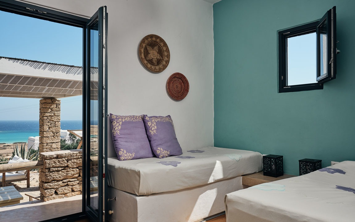 Oceanview Shared Twin with Shared Bathroom - $3050 (Sold Out) - Connect with your roomie in this shared twin room (with an ocean view!) with two twin beds and a shared bathroom with one other room.