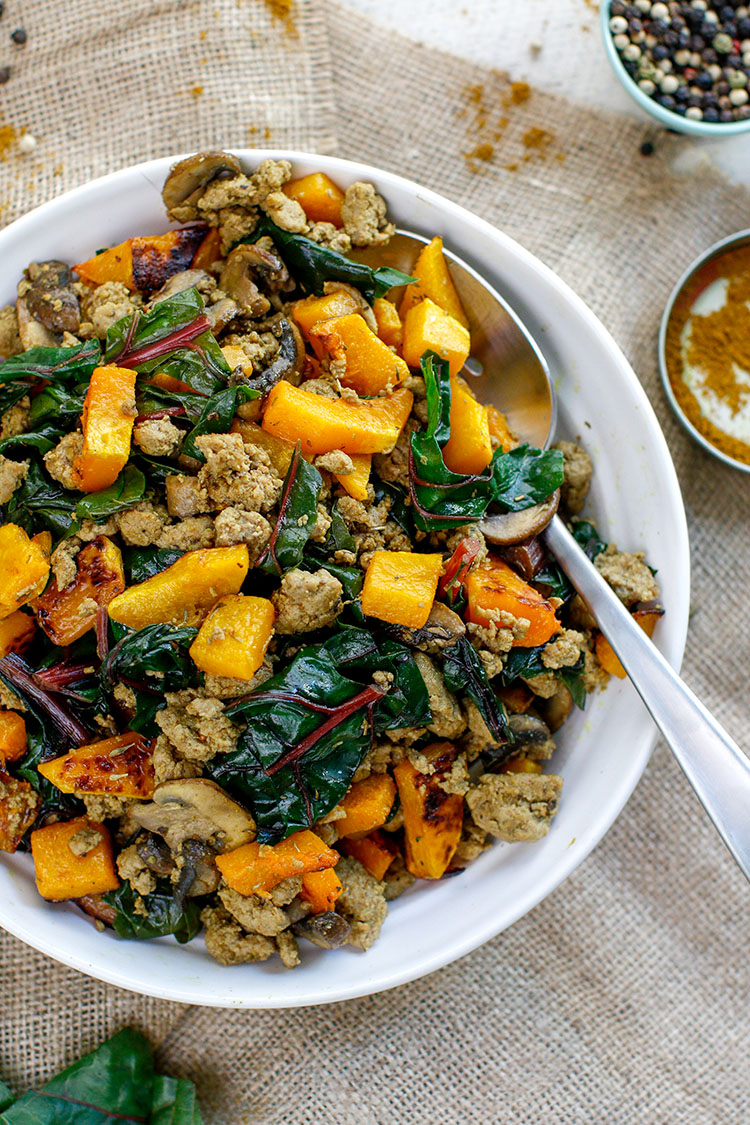 A healthy turkey breakfast butternut bowl filled with maple turkey and sautéed chard and mushrooms. Seasoned with an Ayurvedic spice blend and a hint of maple syrup—think, maple turkey sausage!