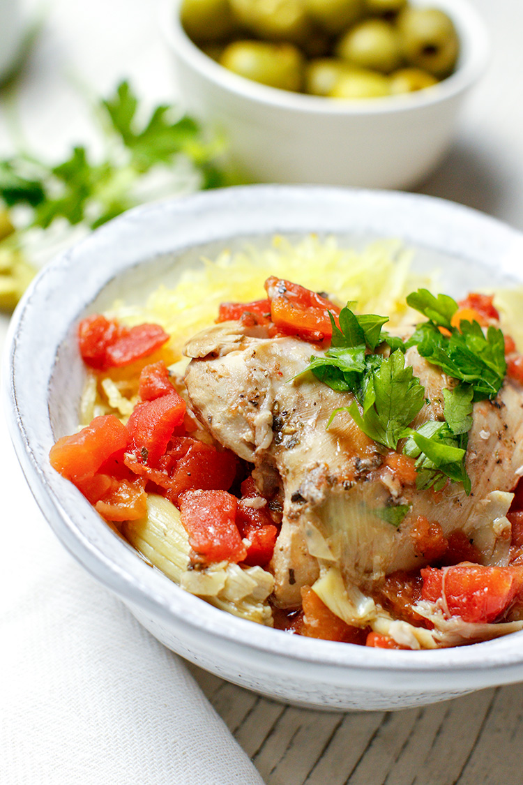 An easy slow cooker Mediterranean chicken recipe—cooked in a soupy tomato broth made with tomatoes and artichoke hearts. Simple enough for any night of the week! Perfect on top of spaghetti squash, rice or your favorite noodles. #healthyrecipe #slowcookerrecipes |  offthebeetenplate.com