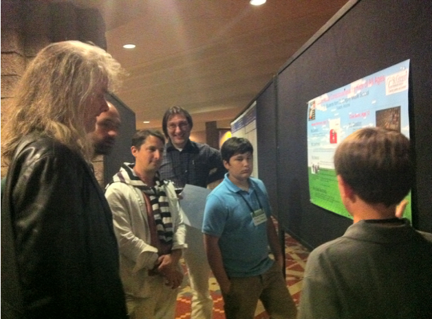 """Middle schoolers presenting their work on """"Selves in Video Games"""" to Uriah Kriegel and David Chalmers (organizers)at the international Towards a science of Consciousness conference, in Tucson, AZ, 2012."""