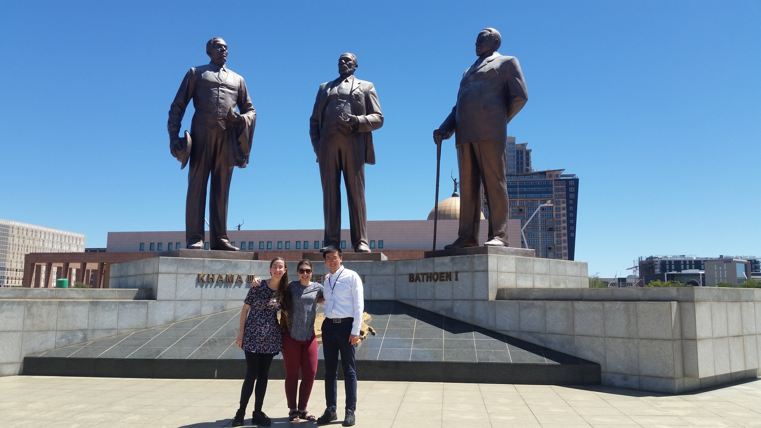 From left: Alexandria Cruz, Alex Hsain, and John Wang. Posing in front of the three chiefs statue in downtown Gaborone, Botswana.
