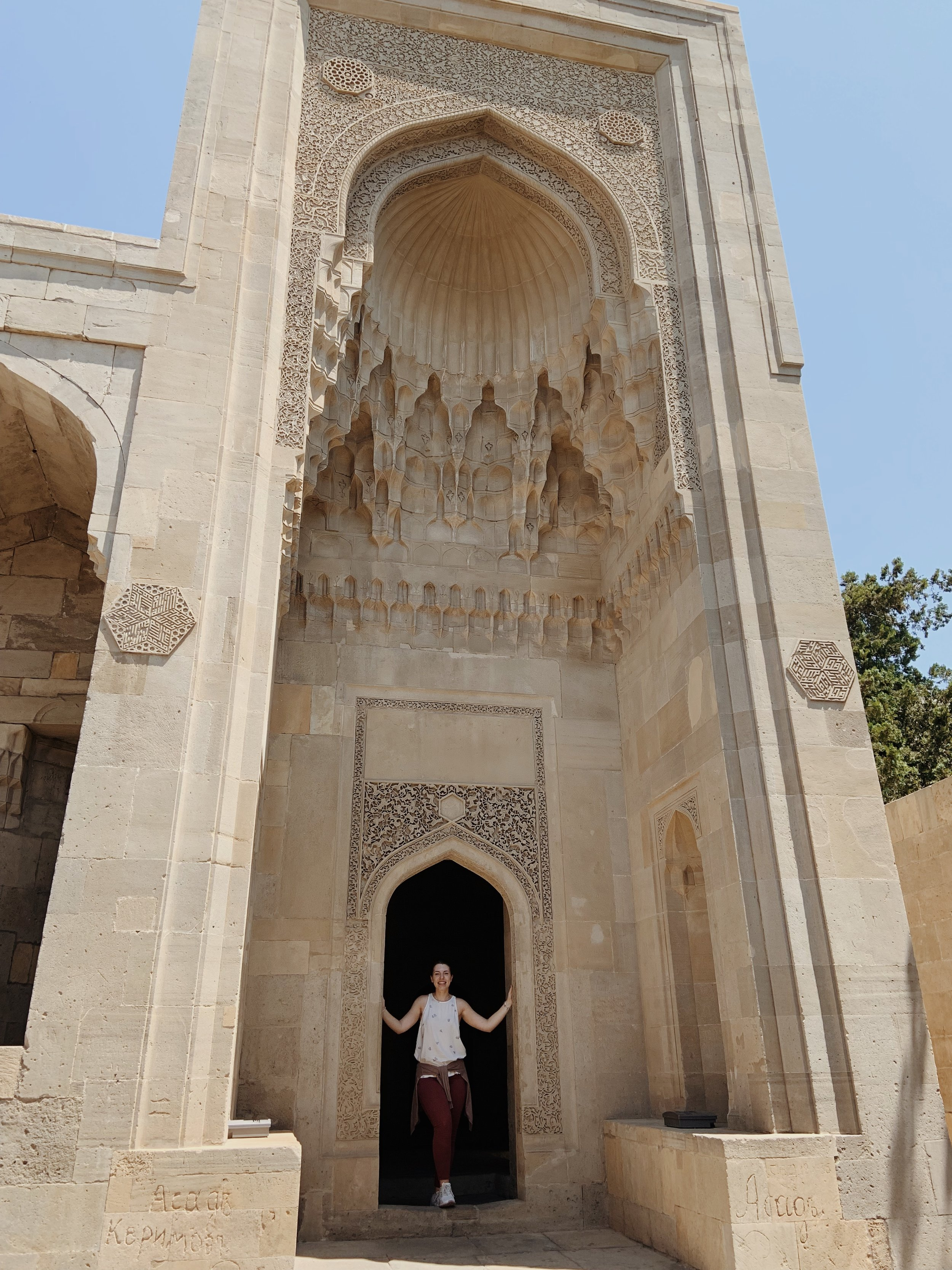 Standing at one of the gate's to the Palace entrance.