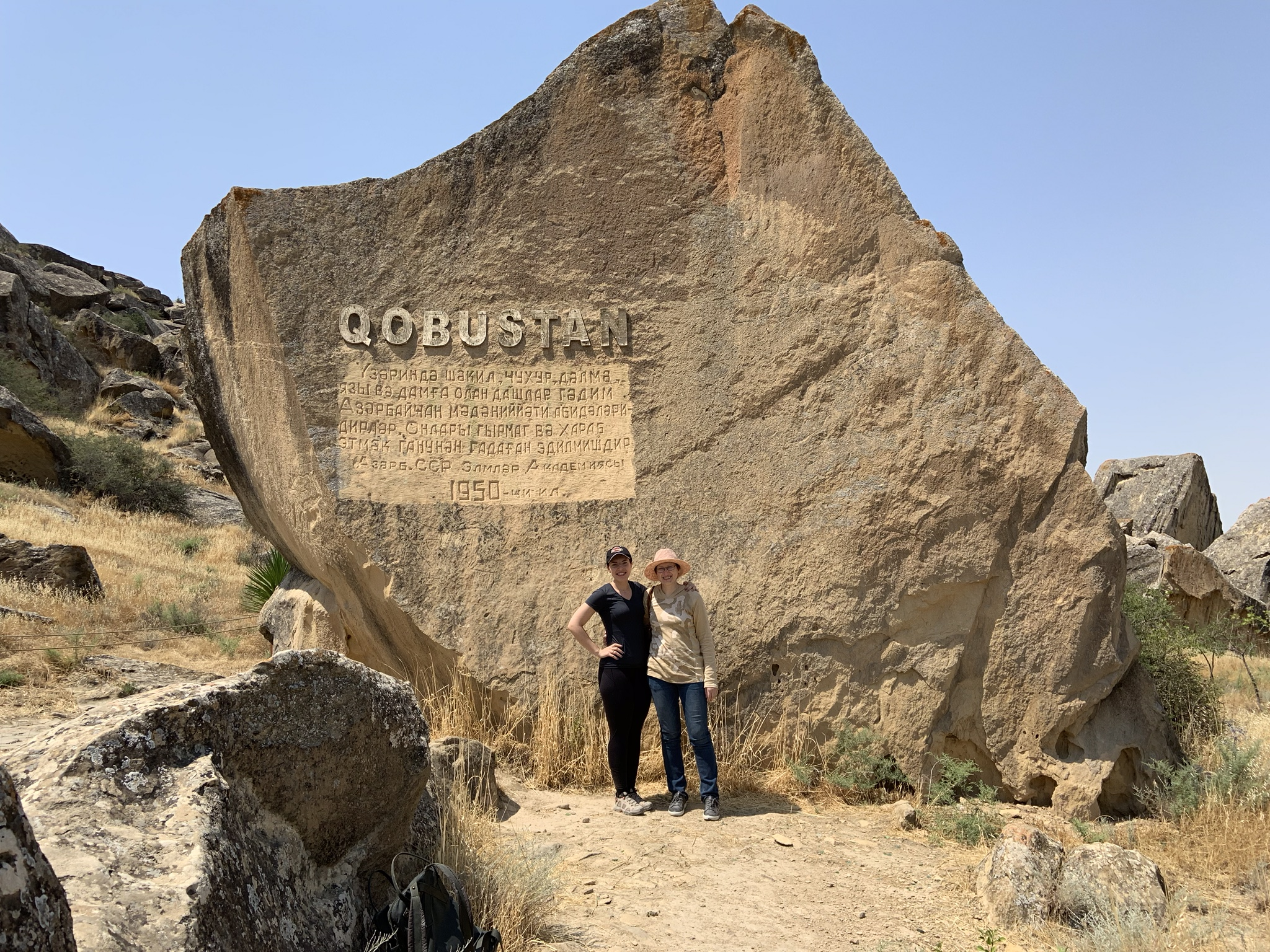 My aunt and I outside of the Gobustan National Park. She had taken the same photo over 20 years ago on a school trip with my mom.