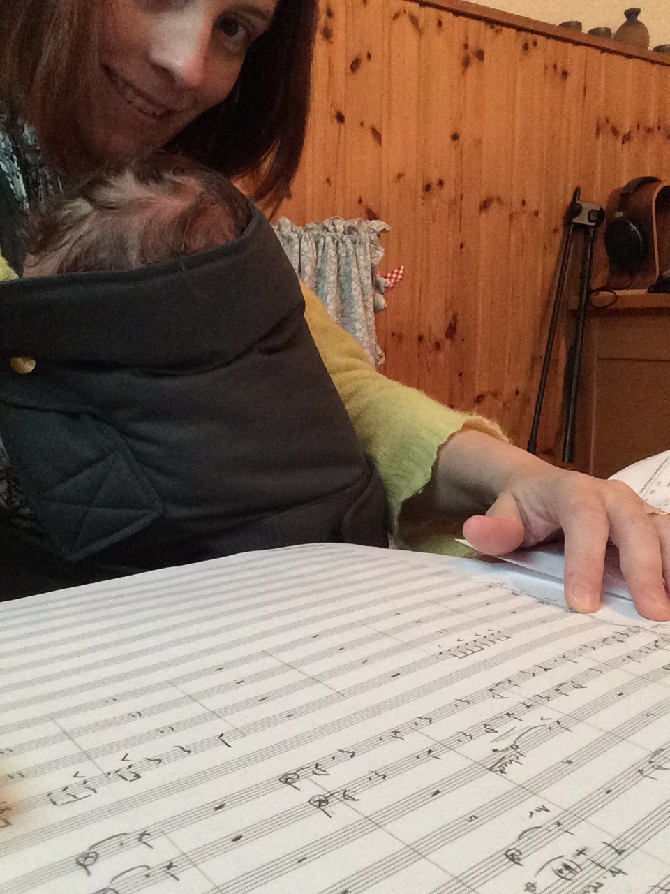 "Catherine Kontz and Edgar. ""Selfie whilst composing for Orchestra with son sleeping on me."""