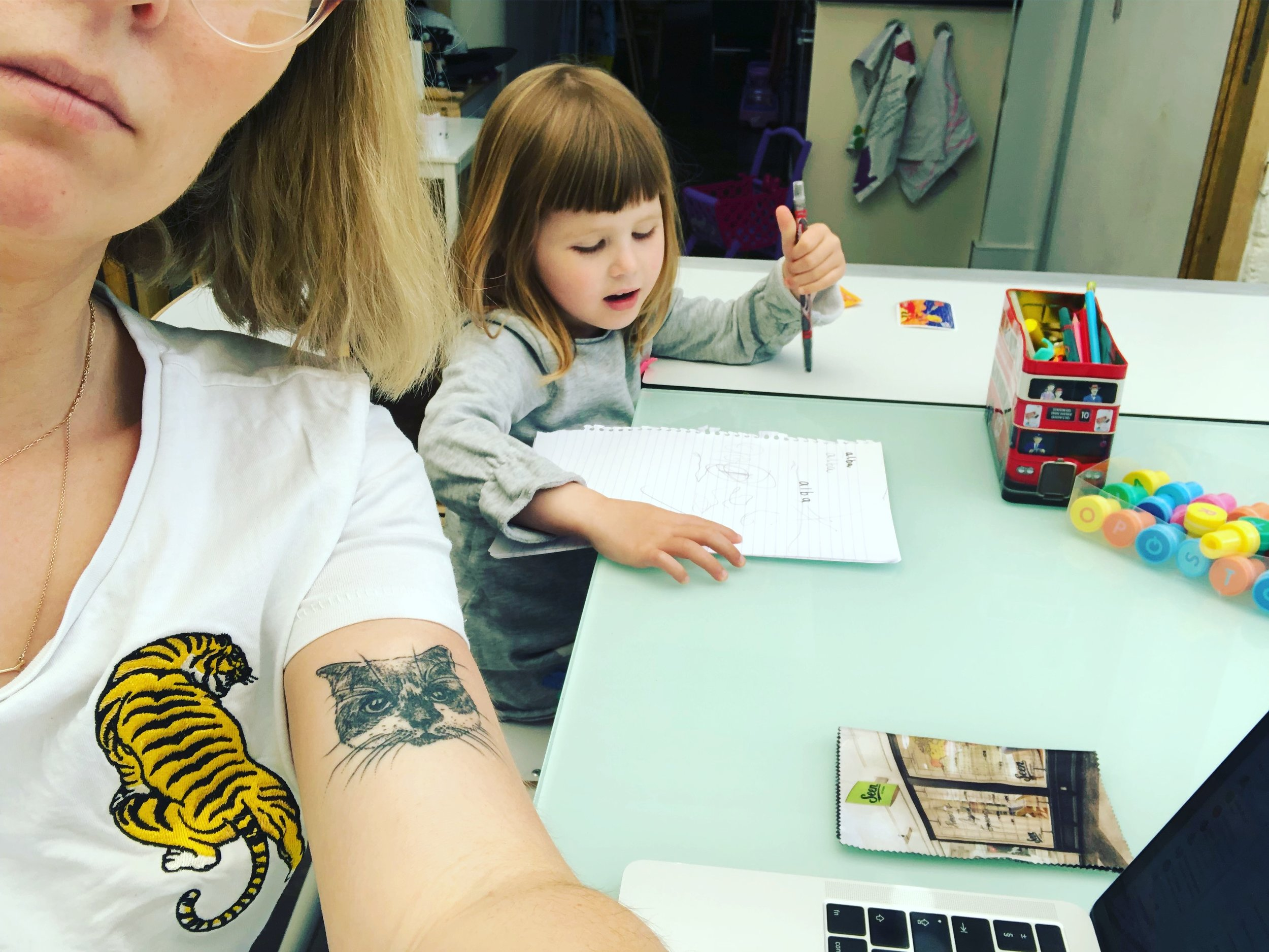Anna Woolf, PhD candidate at Royal Central School of Speech and Drama. Writing part of my arts in health practice based theatre PhD whilst my daughter draws next to me.