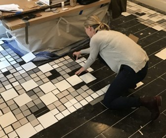 Tricia Huntley laying out master bath tile floor