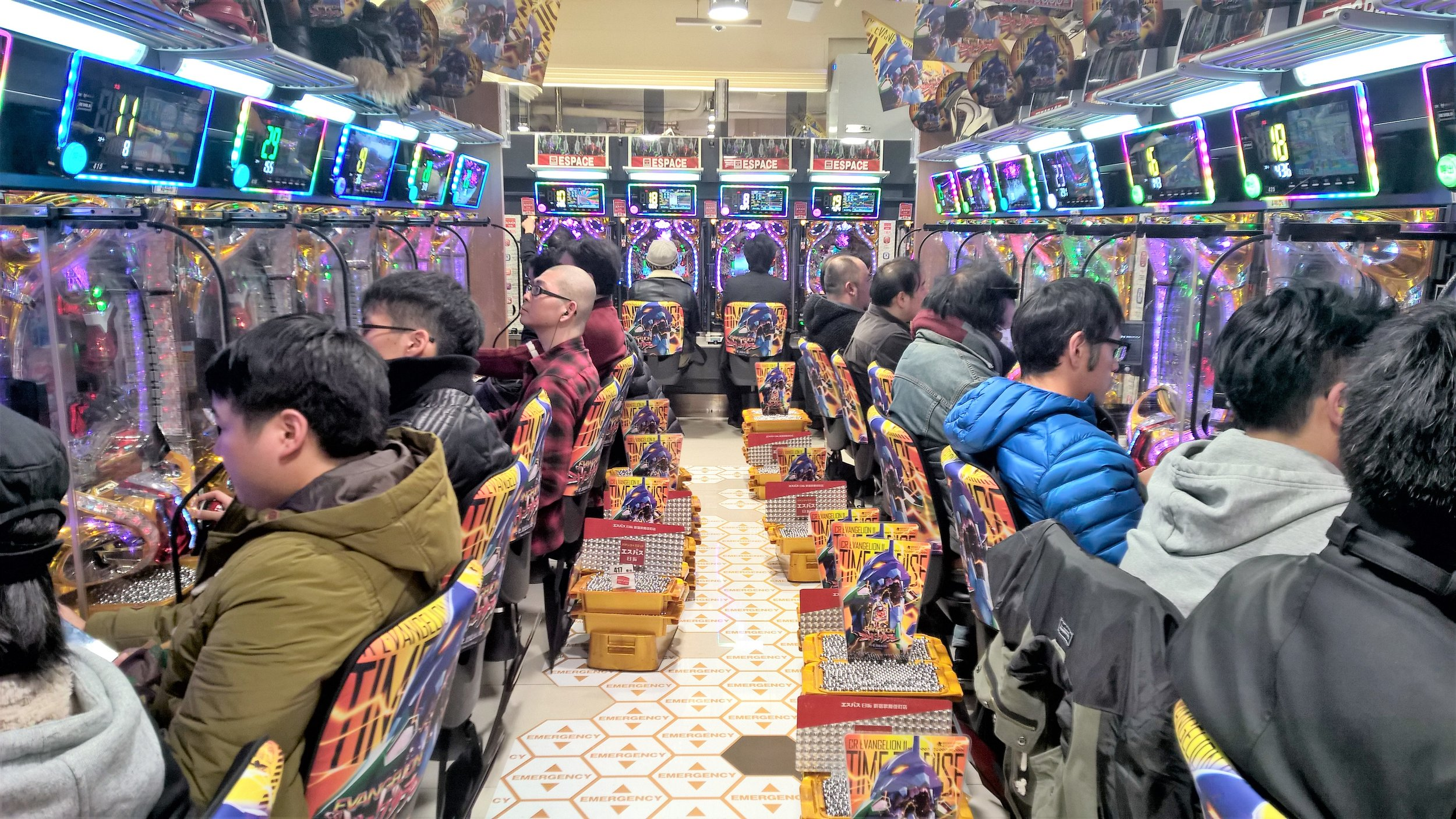 Pachinko parlors. - Pachinko (パチンコ) is a type of mechanical game which originates in Japan and is popular country-wide. It is used as a recreational arcade-style game, but also as a gambling device, comparable to a slot machine. Pachinko parlours are large and loud, reminiscent of a casino. We had many opportunities to visit these parlours, finding them in every city. They are easily identifiable for their bright lights and the noise. We never brought ourselves to try to play a game of pachinko, because the noise in these parlors was truly too overwhelming. We also ventured into gaming arcades in Osaka. These arcades are often entire buildings, filled with every game imaginable. We watched some pro gamers win big, and lost ourselves some yen, but worth it for the thrills.