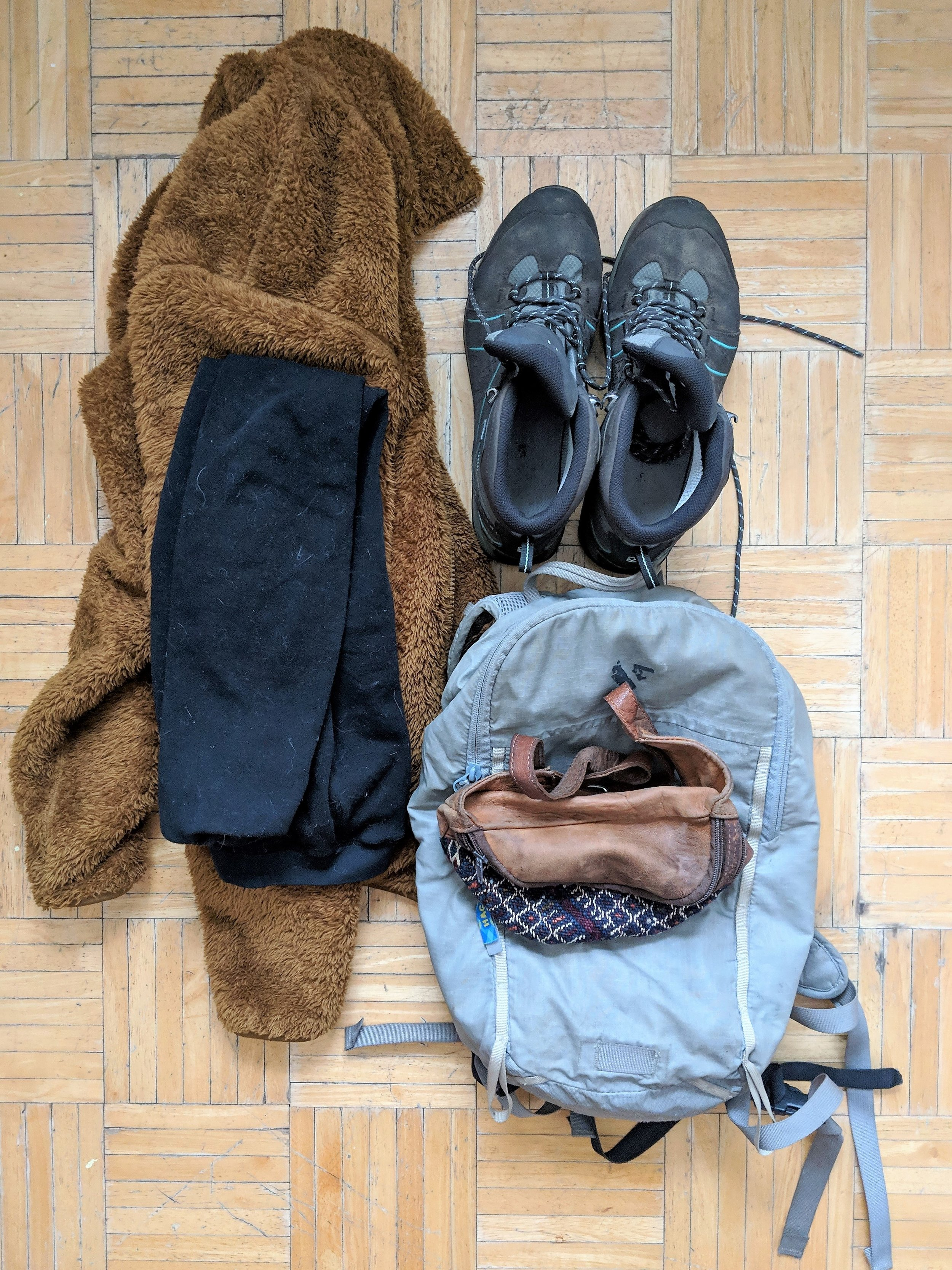 Plane gear. - On the plane I am all about comfort. I wear thermal leggings, a turtle neck and fuzzy zip up sweater - all from Uniqlo. I wear my hiking boots, a fanny pack/ bum bag, and my small day pack of essentials.