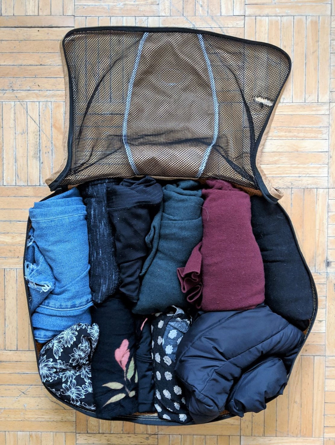 Packing cubes. - Packing cubes are my favourite packing hack! I bought my current set off Amazon for less than 25 CAD. In this cube I have packed all my clothing for the trip: 1 pair of jeans, 1 skirt, 1 sweater, 1 light down jacket, 2 t-shirts and 3 long sleeve.