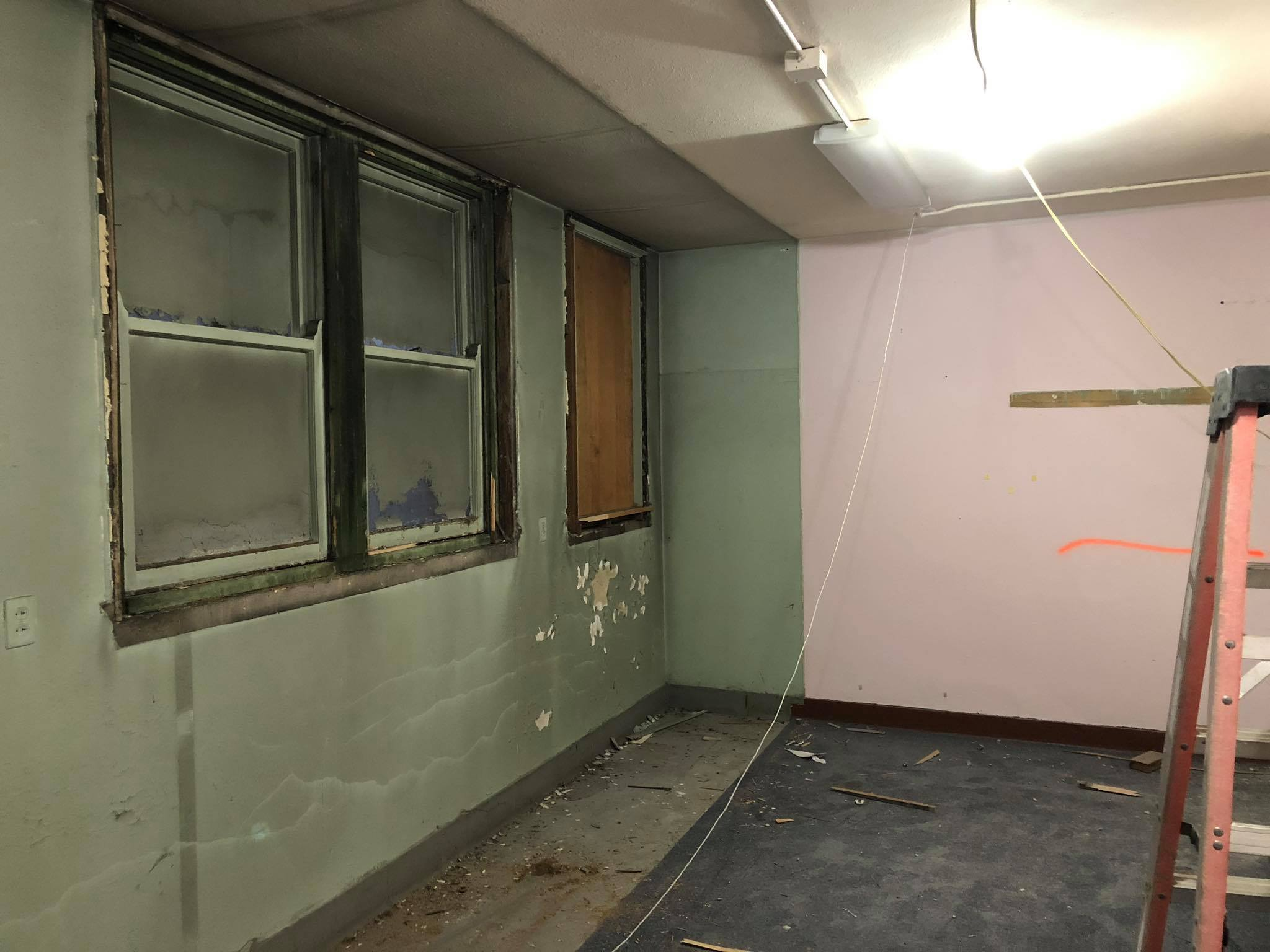 These windows were hidden behind the vesting cabinets on the main level.