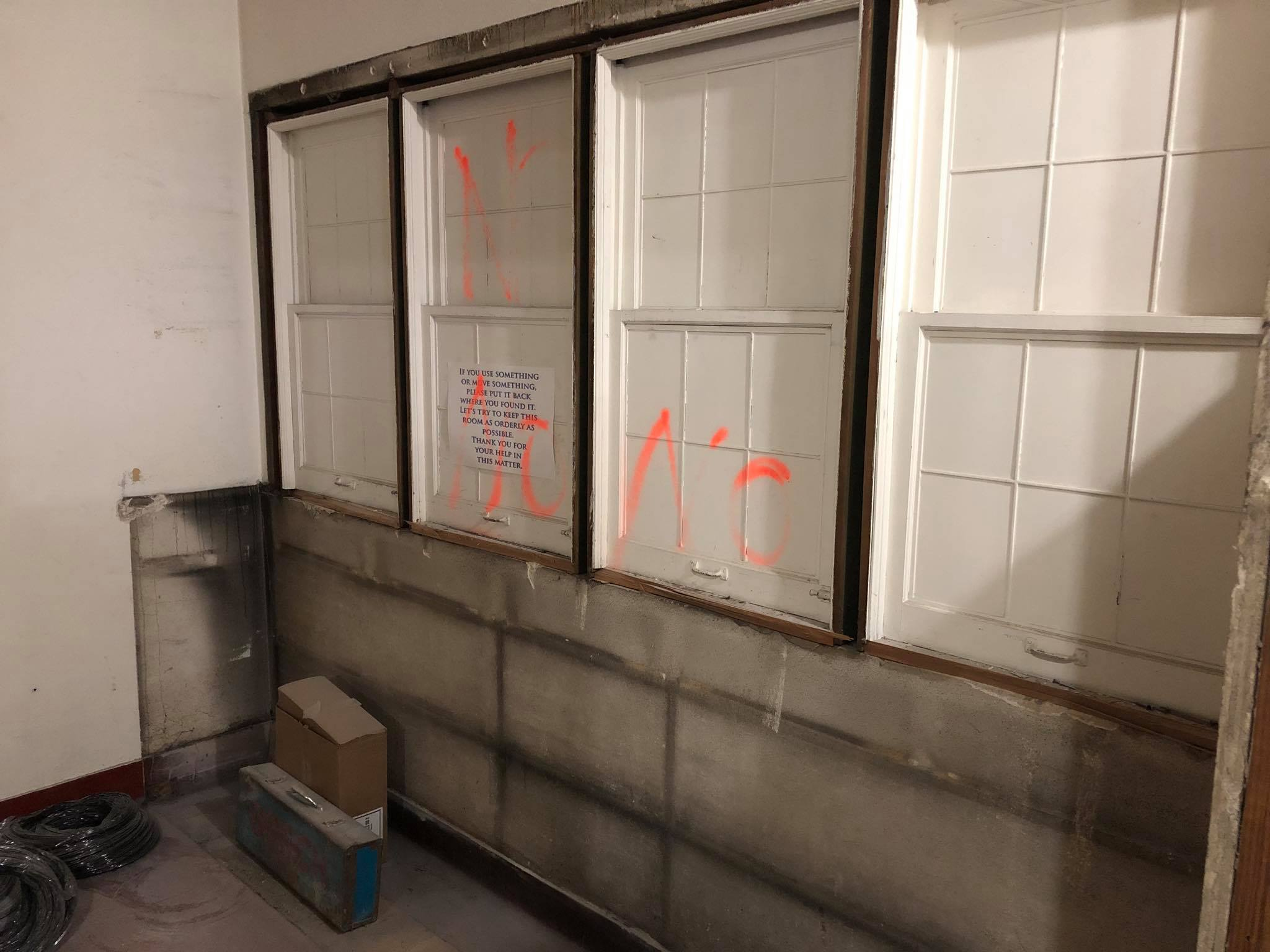 The original reception counter windows from the building's first iteration as the South Bend Clinic.