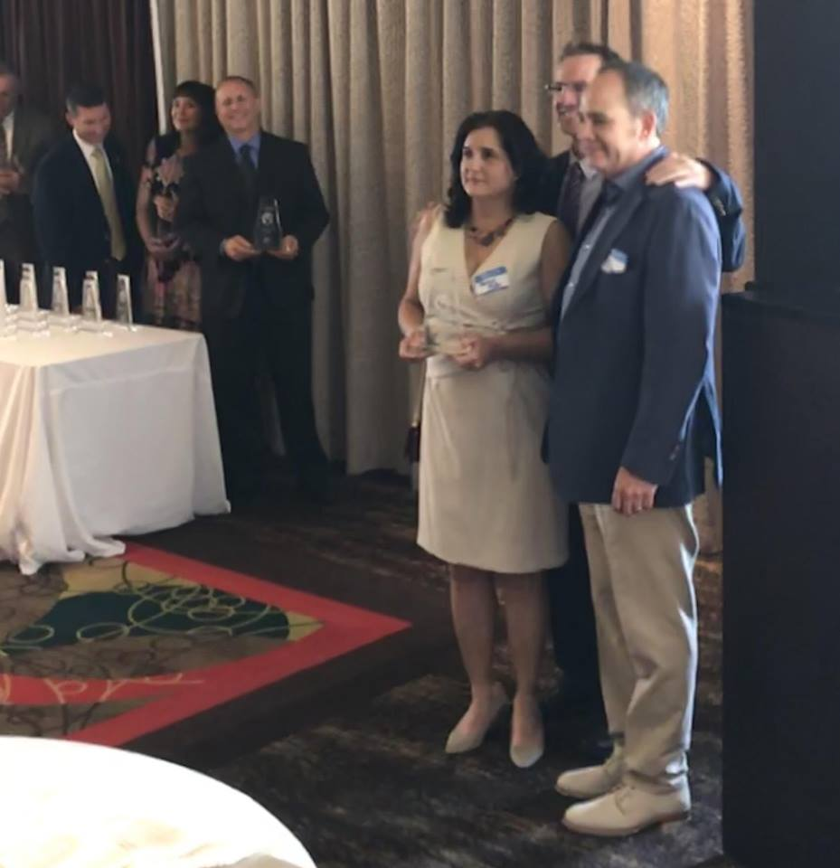 Phillip and Monica Miller Accepting Lagniappe's Award