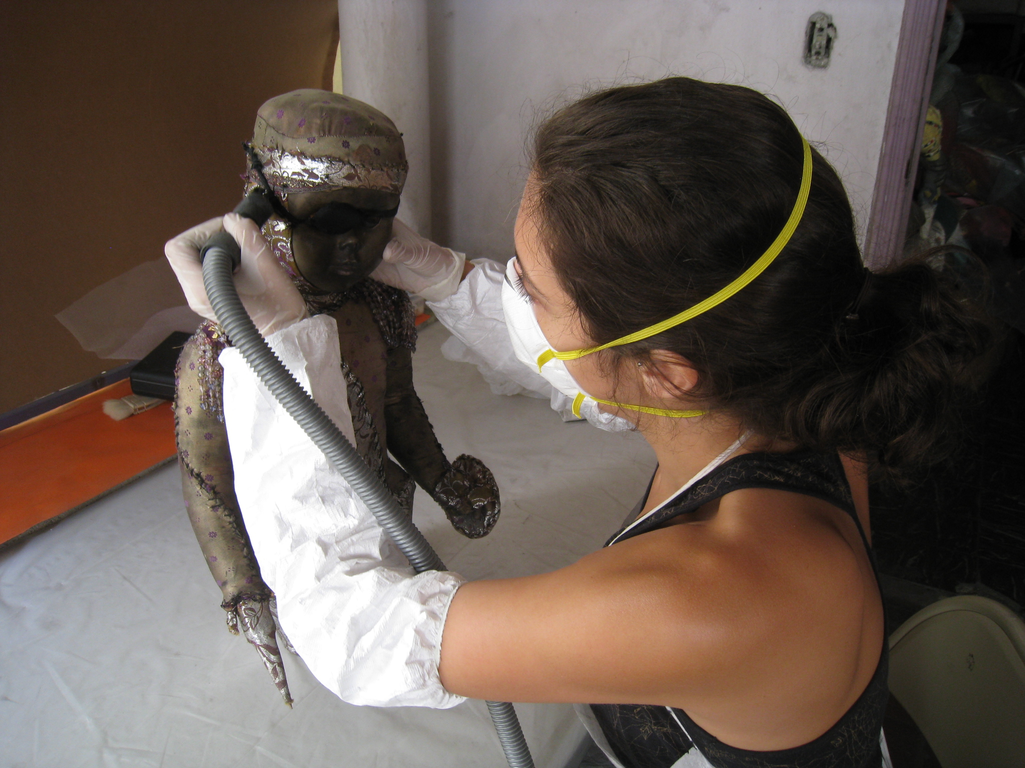 Vacuuming a Bizango doll in the Marianne Lehmann Vodou Collection