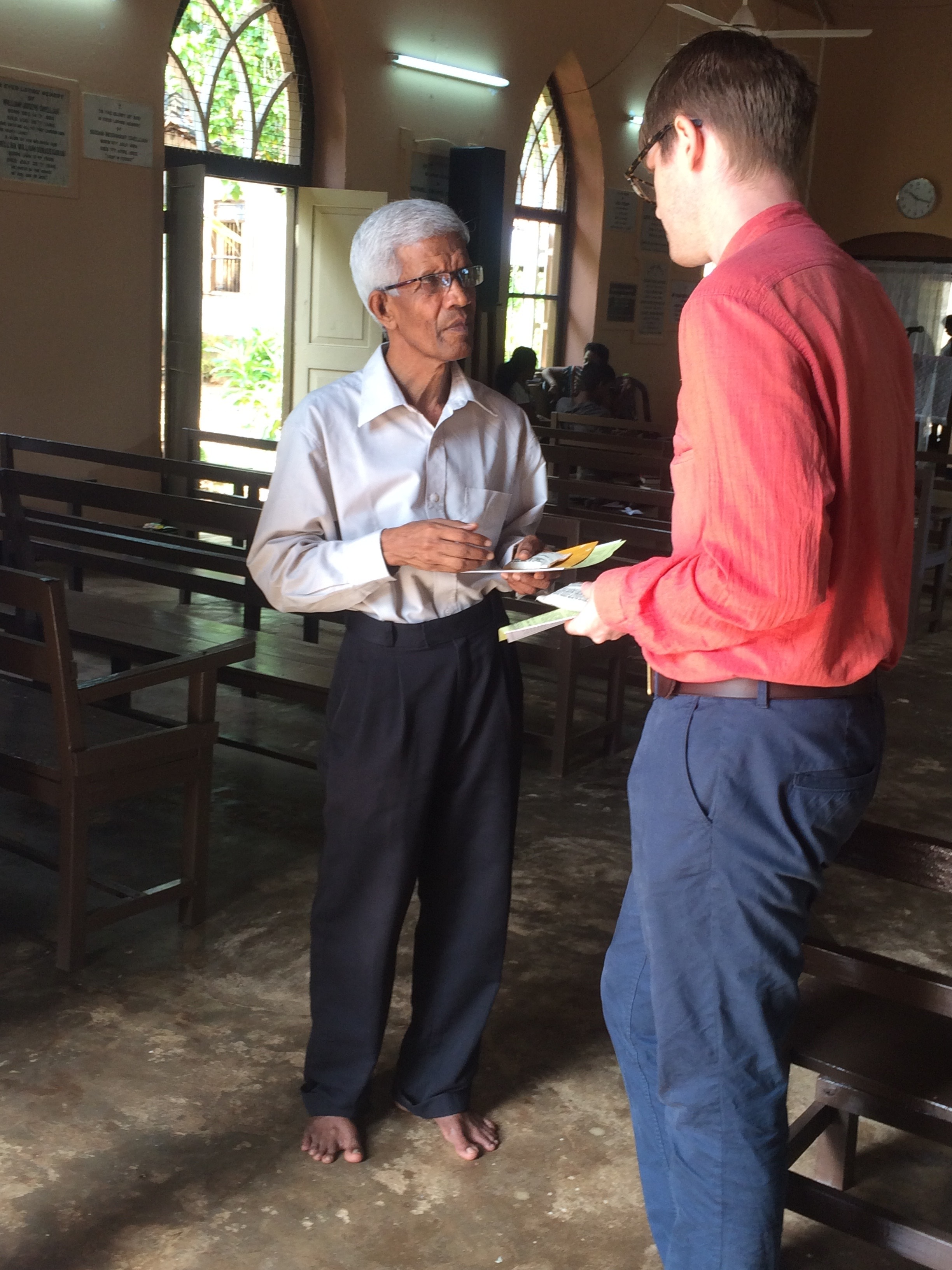 Distributing project information at Tellippalai church. Photo Credit: Henria Aton