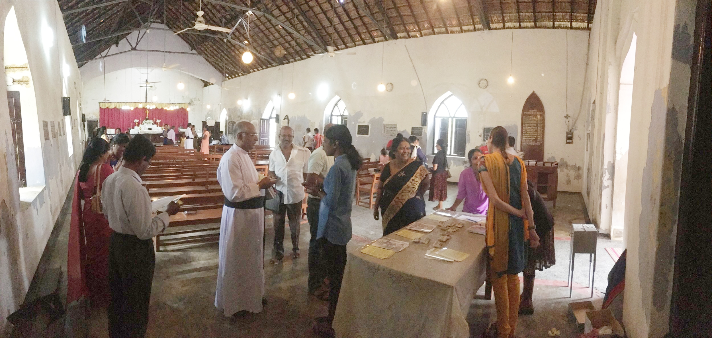 Kirubalini Stephan (center) and Henria Aton (right) and Mirusha Kumarakulasingham (far right) distributing project information at Manipay church. Photo Credit: Mark E. Balmforth