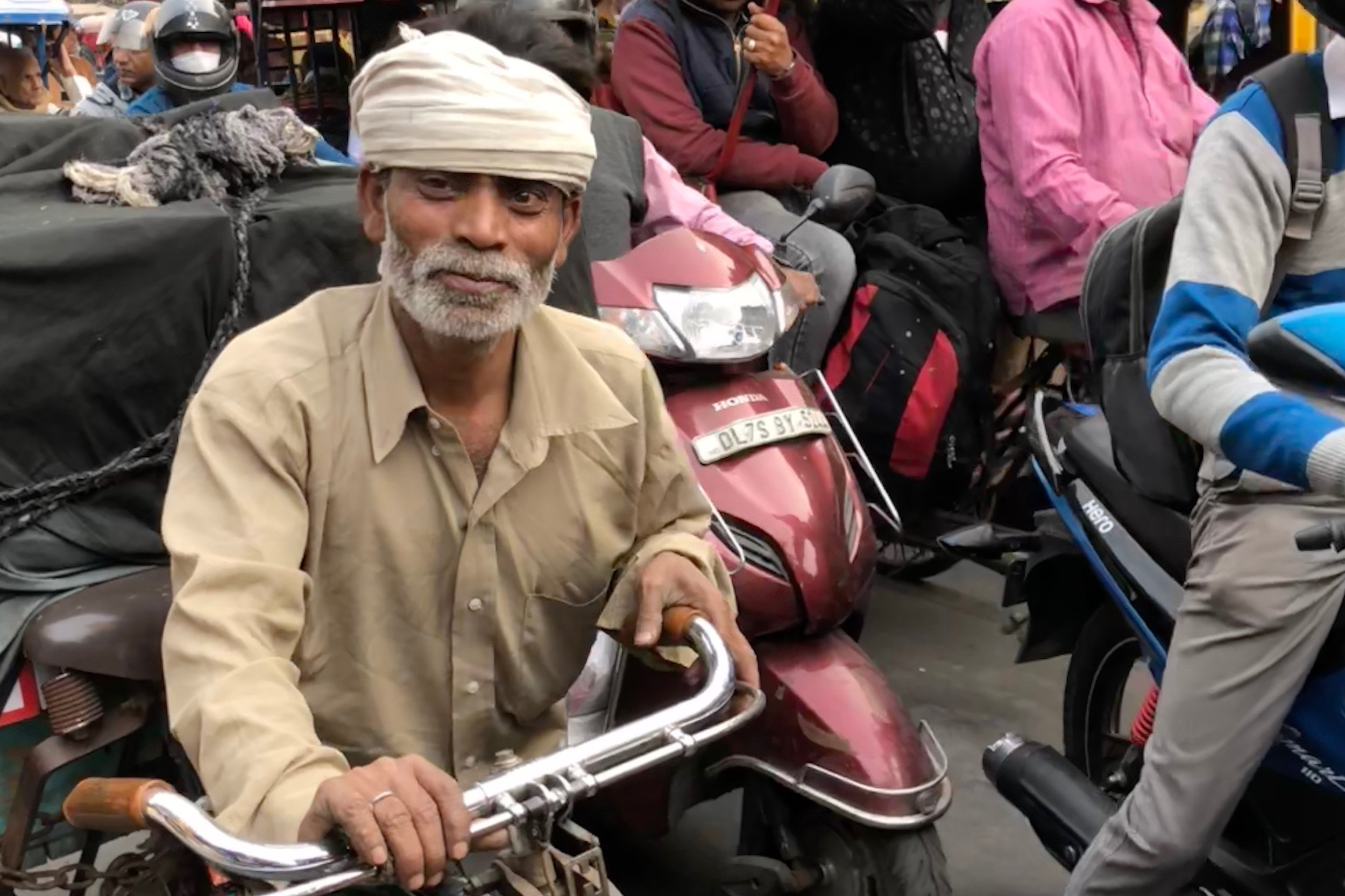 I took this photo, with my subject's permission, while sitting in a traffic jam in Old Delhi, December 2017.