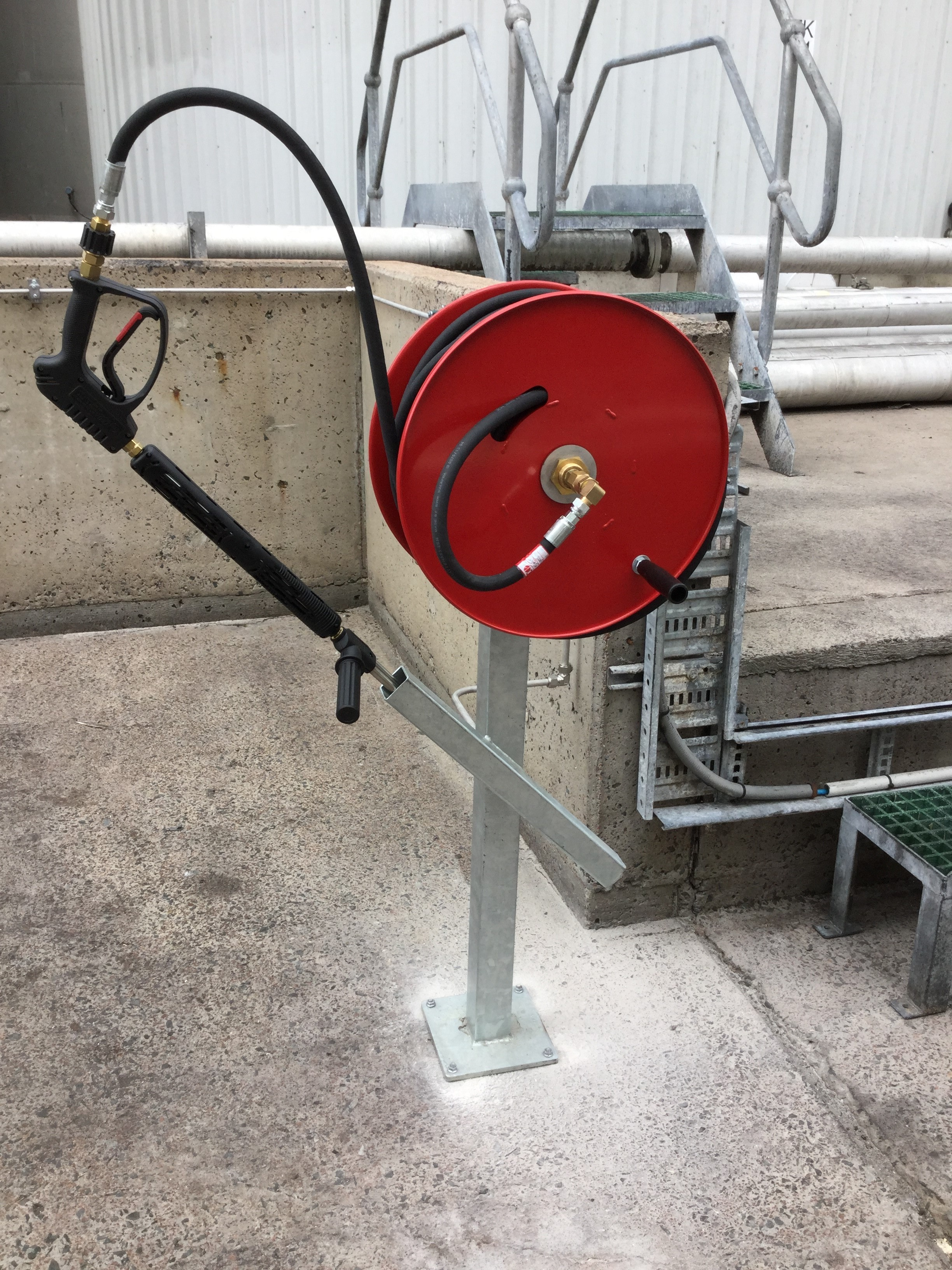 Hose reel stand mounted attached to remote access pipework on plant