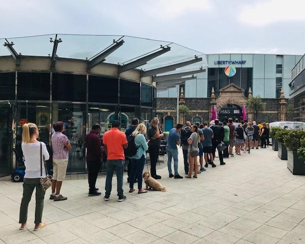 Hundreds Queue for iQ Liberty Wharf Launch -