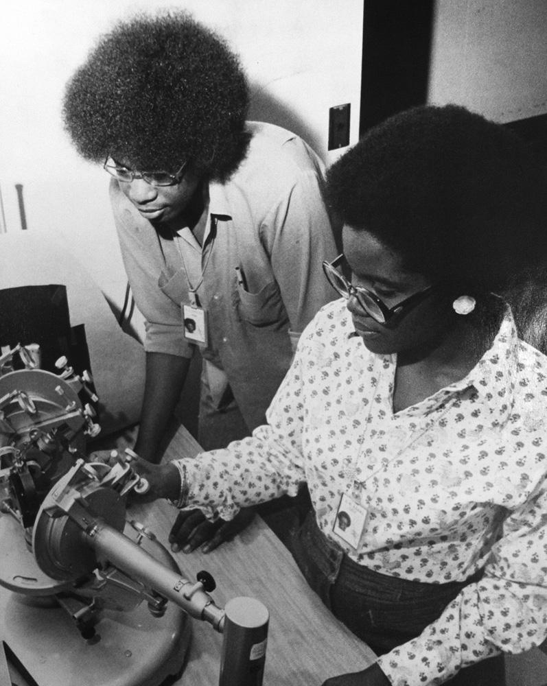 Tennessee University students Michelle Adams (right) of Nashville, TN and Mickey D. Shelton of Petersburg, TN in their second year as interns at Lincoln Lab, June 1977.Photo: Calvin Campbell/MIT News Office, Courtesy MIT Museum