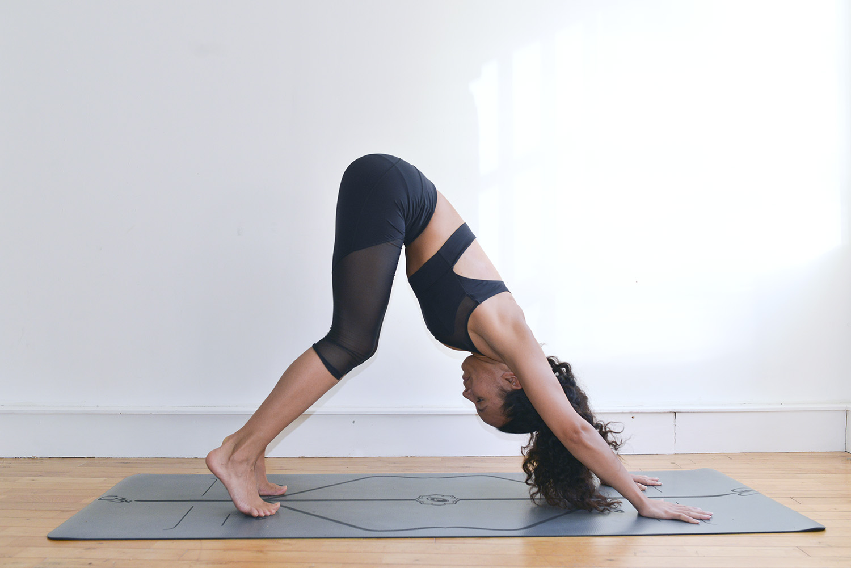 Ashley Bailey in Downward Facing Dog (Adho Mukha Svanasana) with bent knees, by Heather Elton.