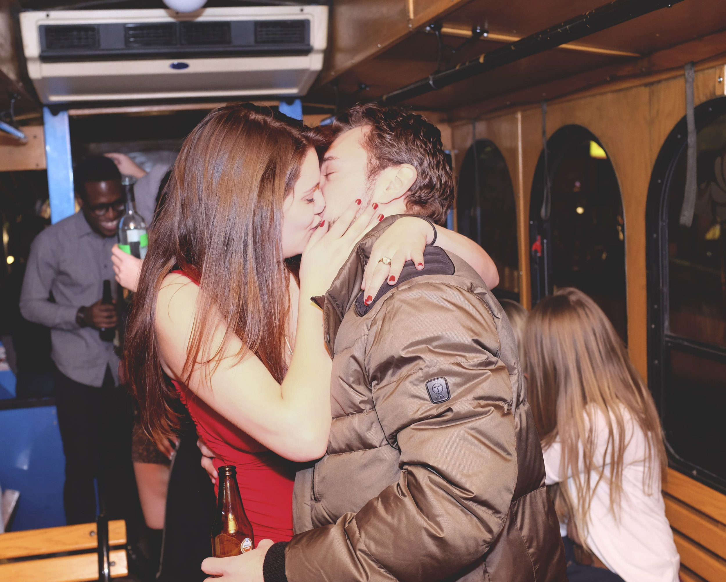 kissing on a trolley party bus