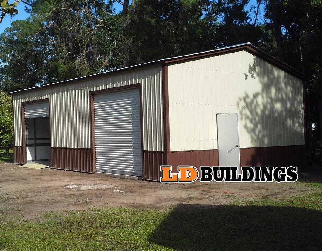26x40 w concrete foundation. Two tone wainscot vertical siding option.jpg