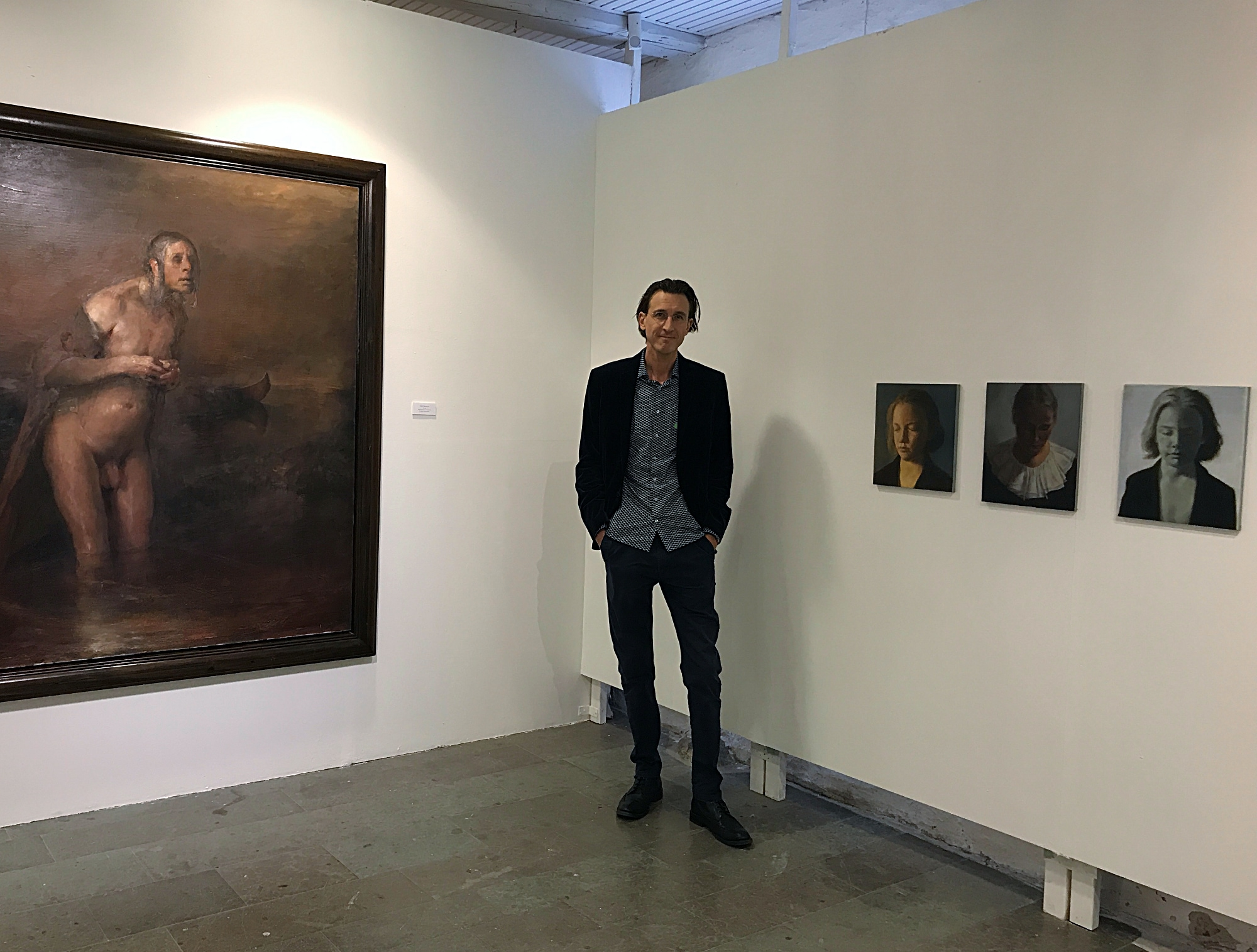 Black Star, Edsvik Konsthall 2018: Mikael Rydh with the paintings  The Dream ,  Abidance  and  White Hour .  (Odd Nerdrum painting to the left.)