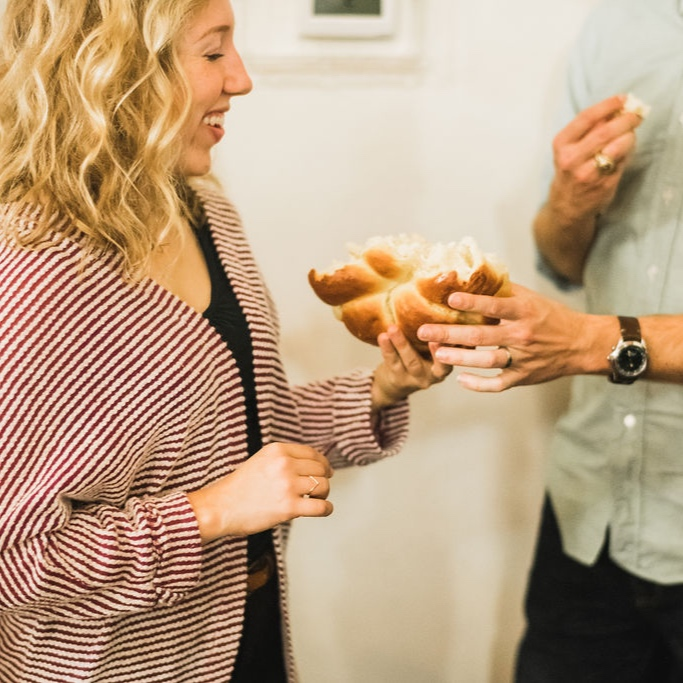 "Communion - We celebrate the Lord's Supper every week by ""circling up"" around the table of fresh baked bread and wine. Once our pastor has administered the sacrament, our members serve one another. (Gluten free communion bread is always available.)"