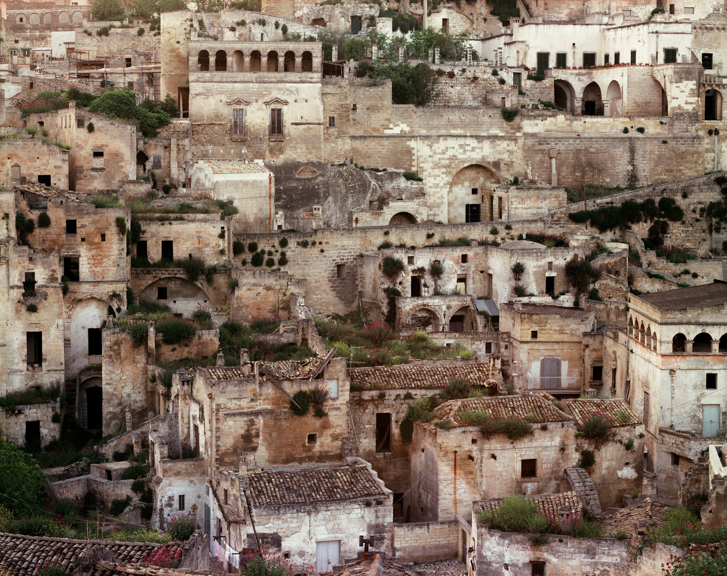 Caves used as dwellings since prehistoric times, modifies with tufa facades, now under restoration, Matera, Italy, 1994