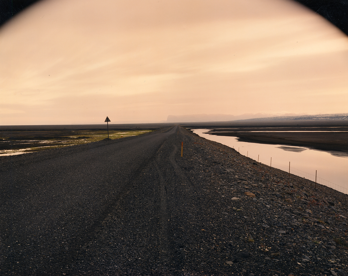 Ring road as it passes between the Black Sand Desert and the glacier-covered volcano Katla, Myrdalssandur, Iceland, 1987