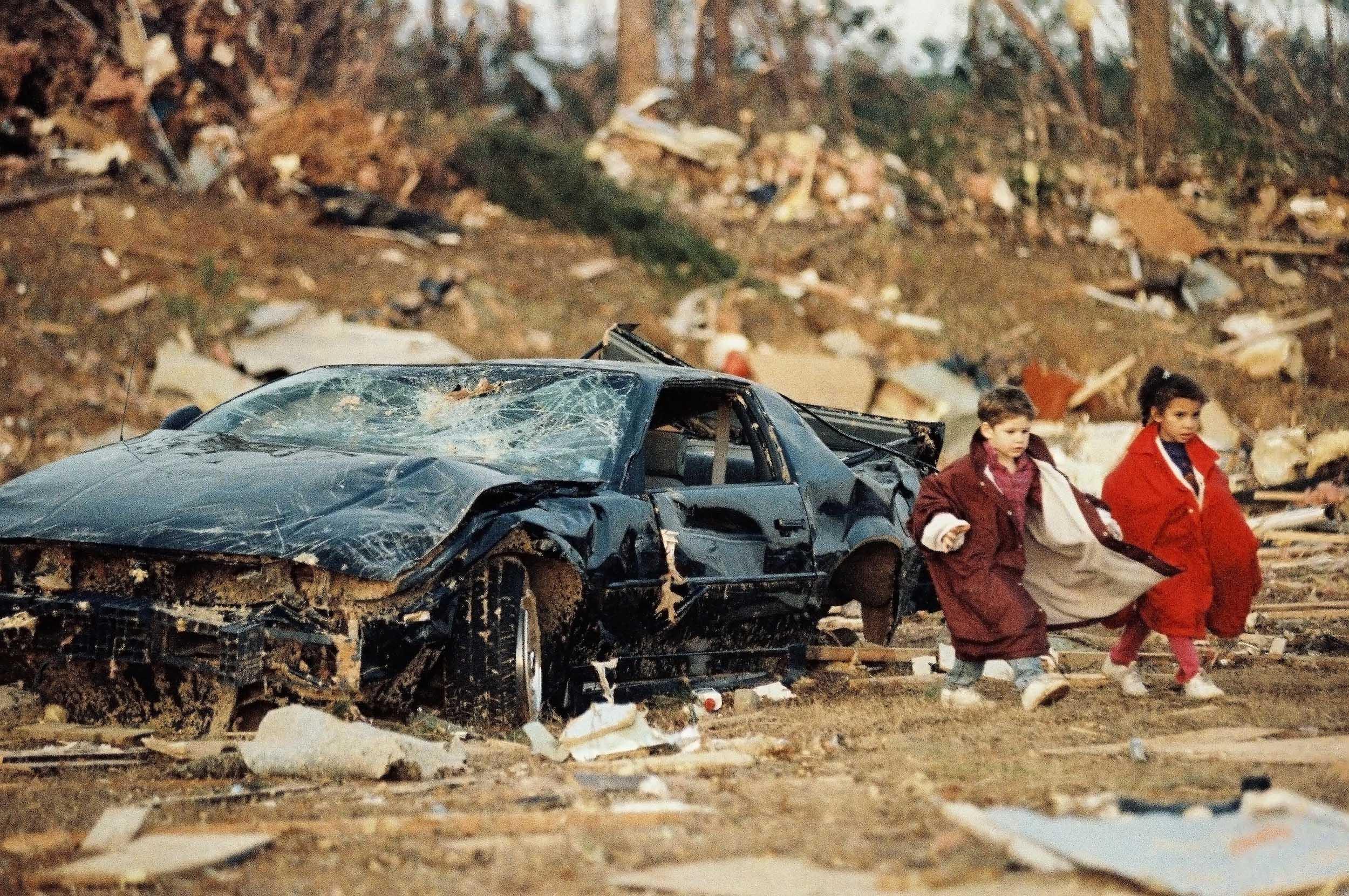 Children Amidst Tornado Wreckage - 2001, © Karen Pulfer Focht