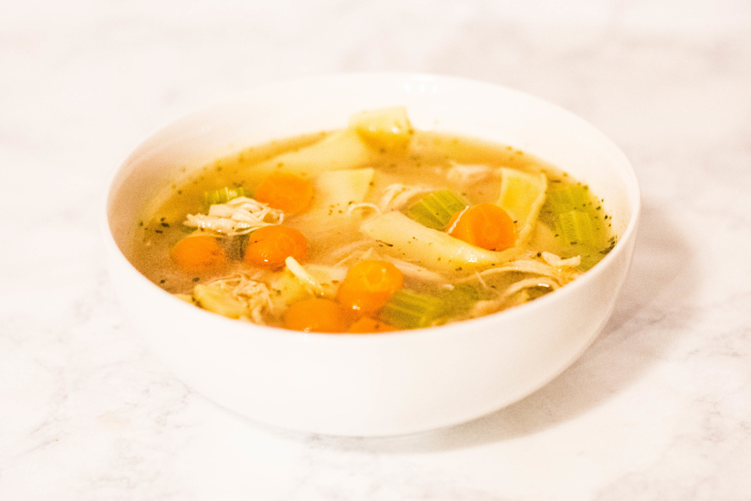 Super simple homemade chicken noodle soup recipe with instructions to cook it using a pressure cooker (like an Instant Pot) and a slow cooker || Hayley Fiser || thehayleyfiser.com