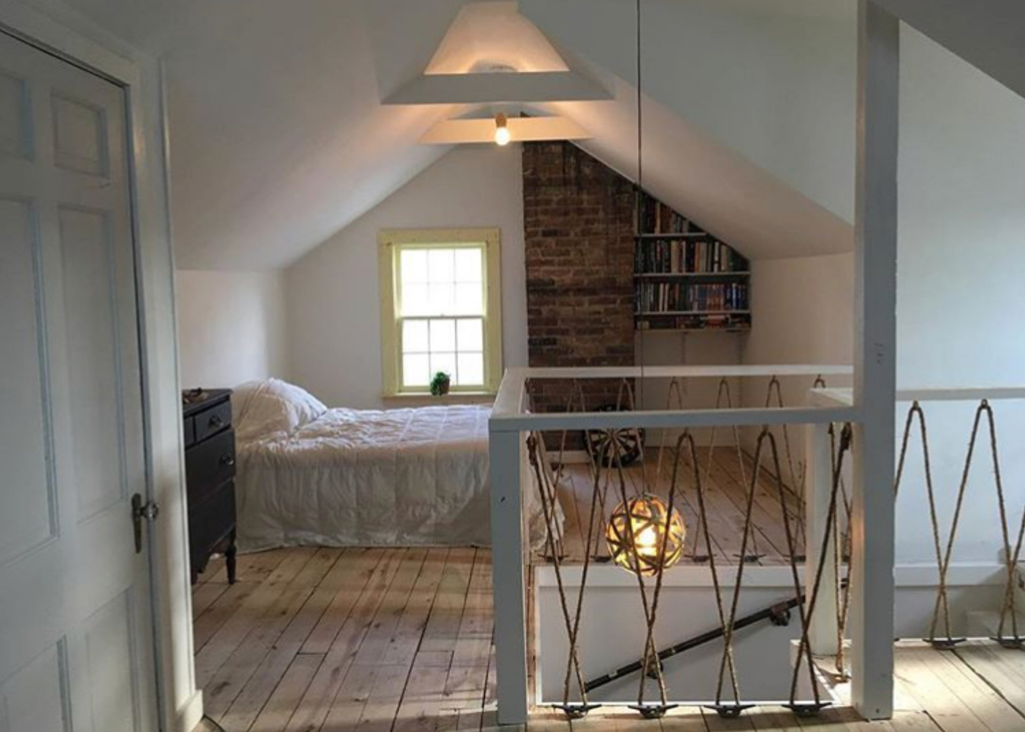 This renovation turned three rundown, second-floor rooms into an open-air boy's room. The job included tearing down walls, adding new vents and insulation, installing new dry wall, removing layers of flooring, refurbishing the subfloor, and designing a new stairwell and lighting scheme