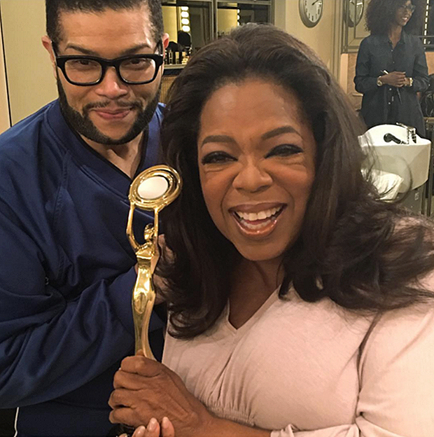 Derrick Rutledge Recipient of the Hollywood Beauty Award is congratulated by his client OPRAH WINFREY
