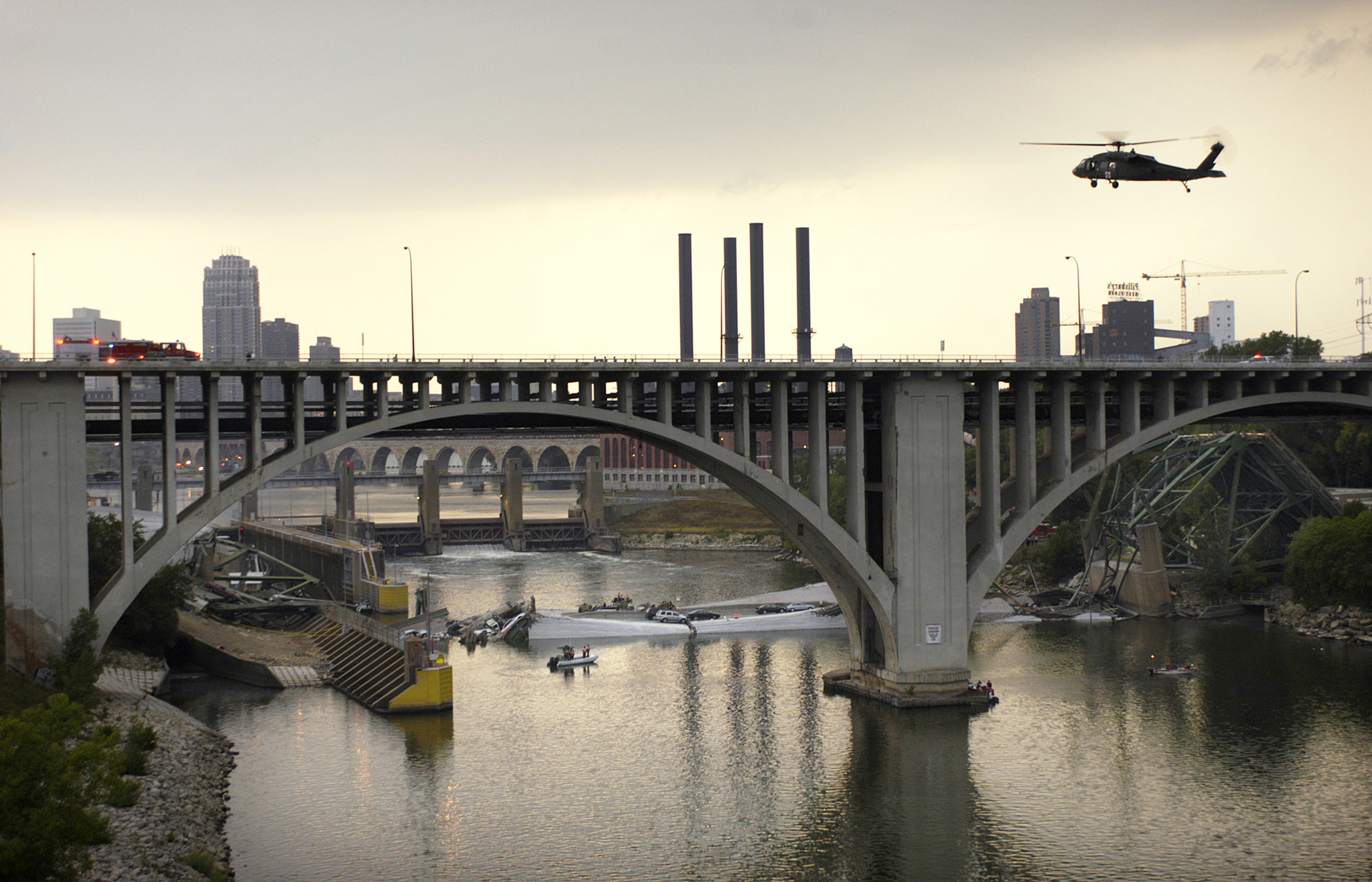 A helicopter lands on the 10th Avenue Bridge shortly after the 35W Bridge collapsed into the Mississippi River on August 1, 2007 in Minneapolis, MN.