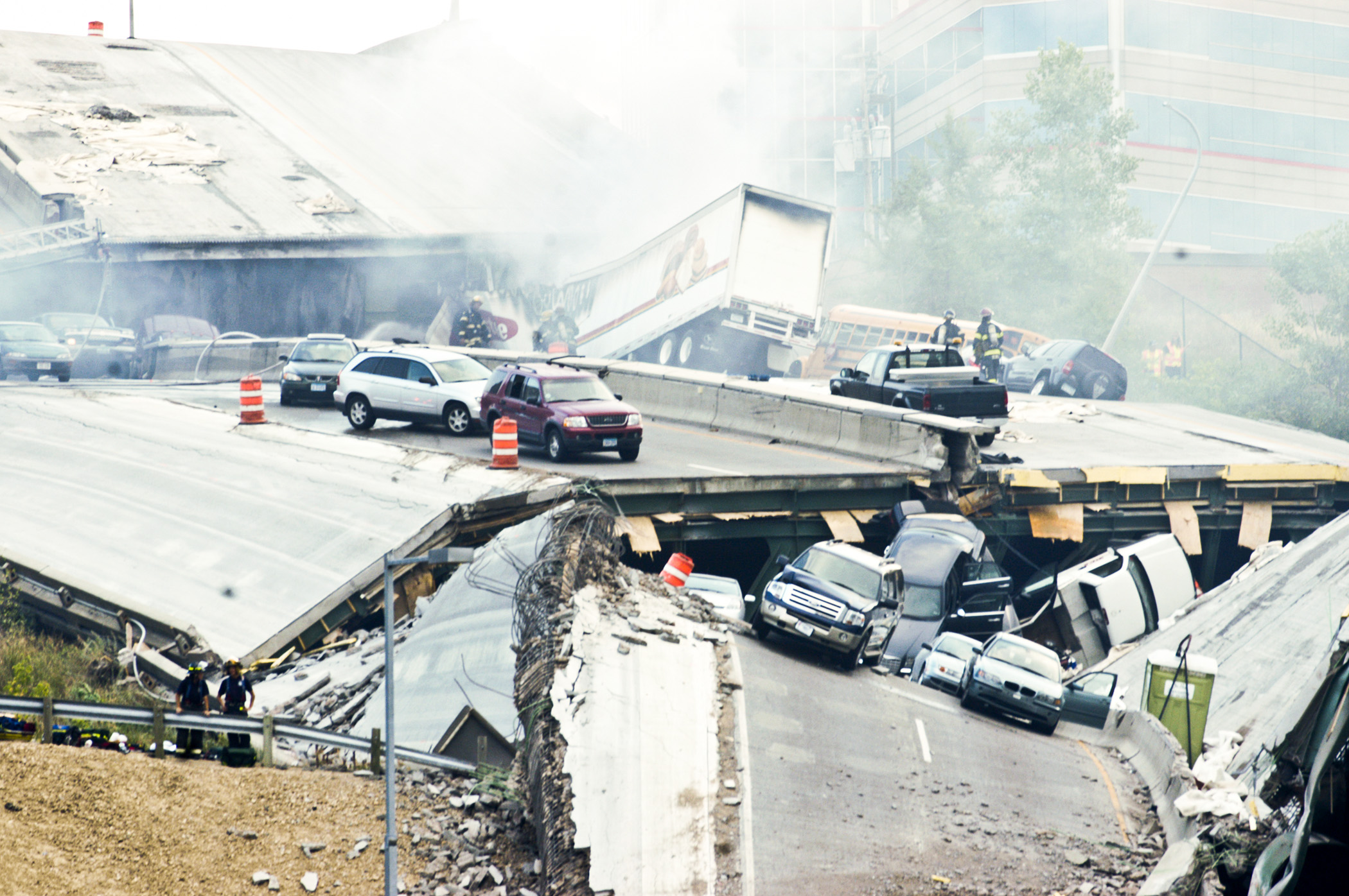 Firemen work to rescue victims of the 35W Bridge collapse August 1, 2007 in Minneapolis, MN. The collapse killed 13 people and left 145 injured.