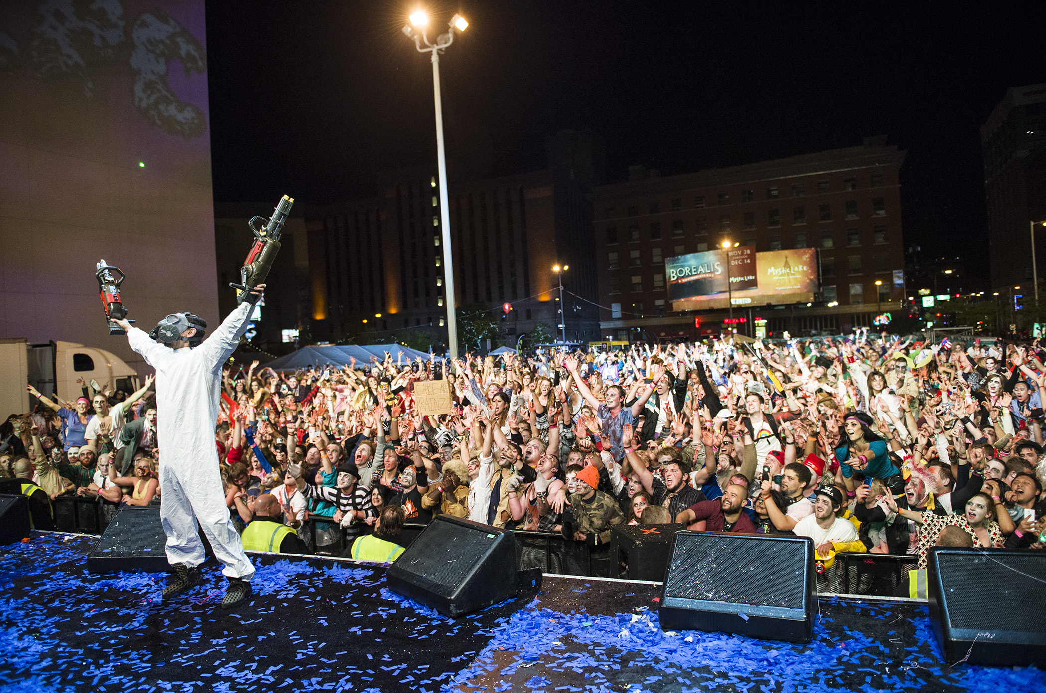 """Steve Aoki performs at the Zombie Pub Crawl X event on October 11, 2014 in downtown Minneapolis, MN. The event claimed the Guinness World Record for """"the largest gathering of zombies"""" with 15,458 participants attending."""