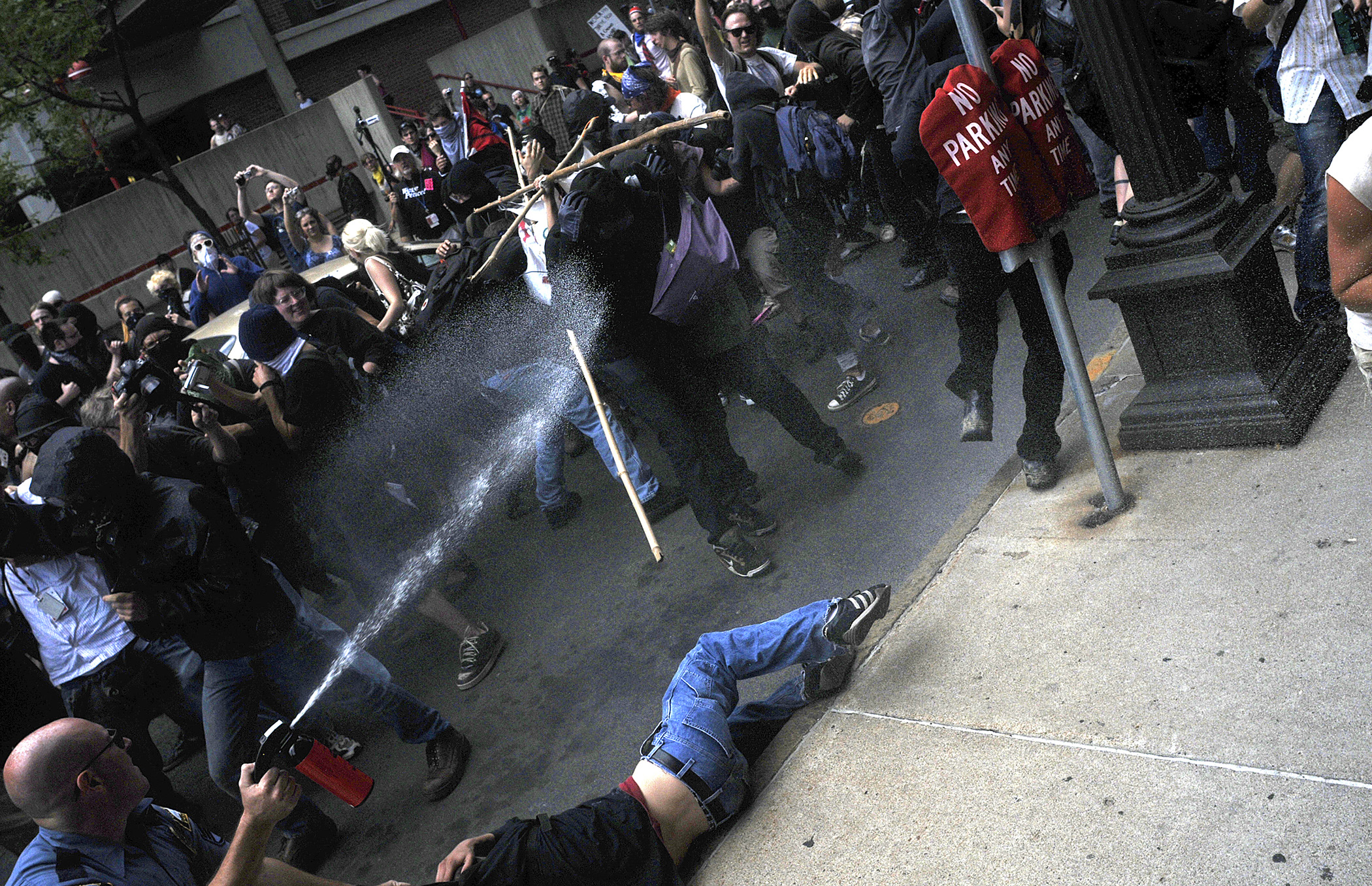 A St. Paul police officer drags a protester to the ground as he pepper sprays the rest of the crowd during the Republican National Convention on September 1, 2008 in St. Paul, MN.