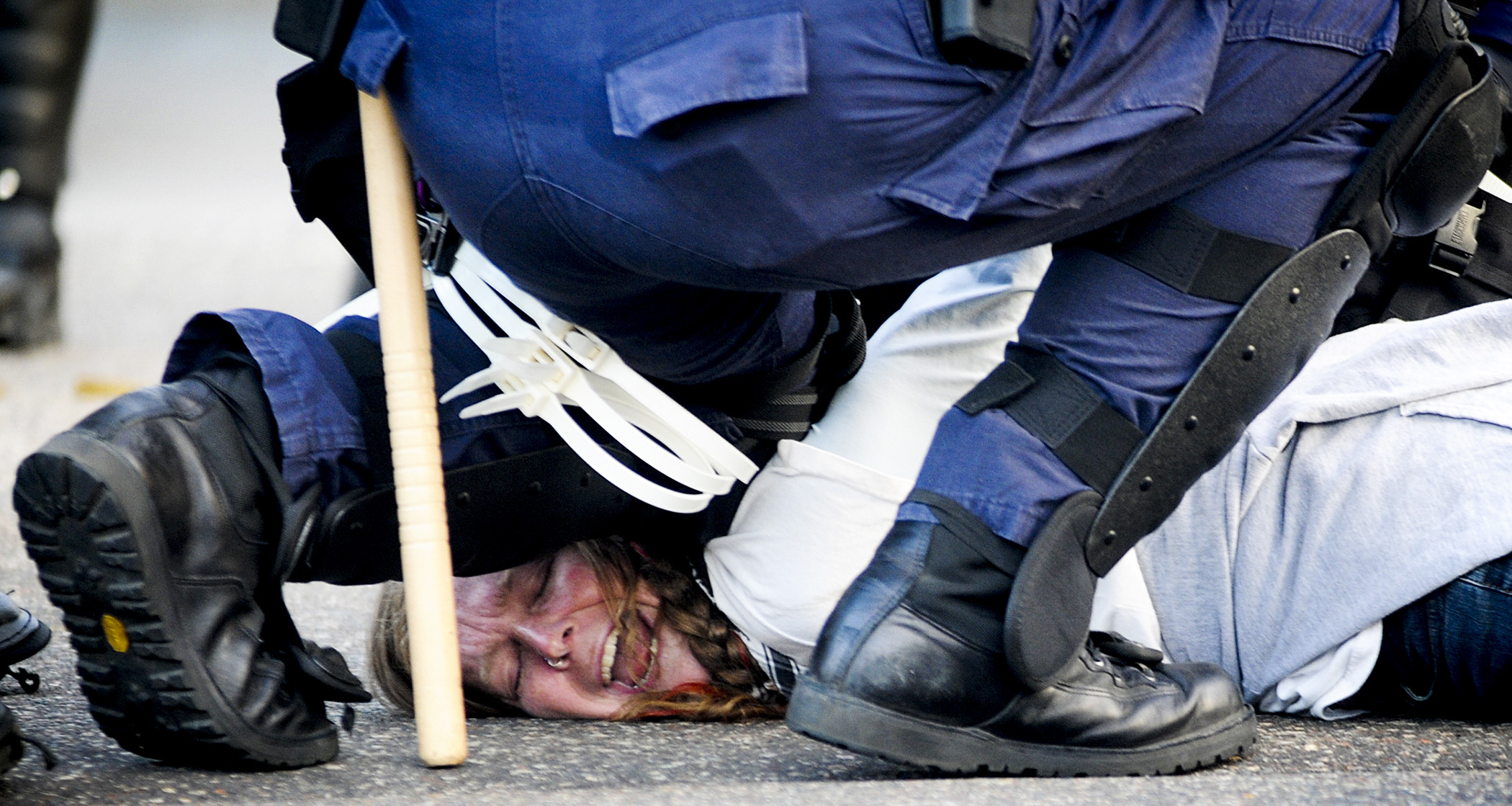 A protester is arrested during the Republican National Convention on September 4, 2008 in St. Paul, MN.