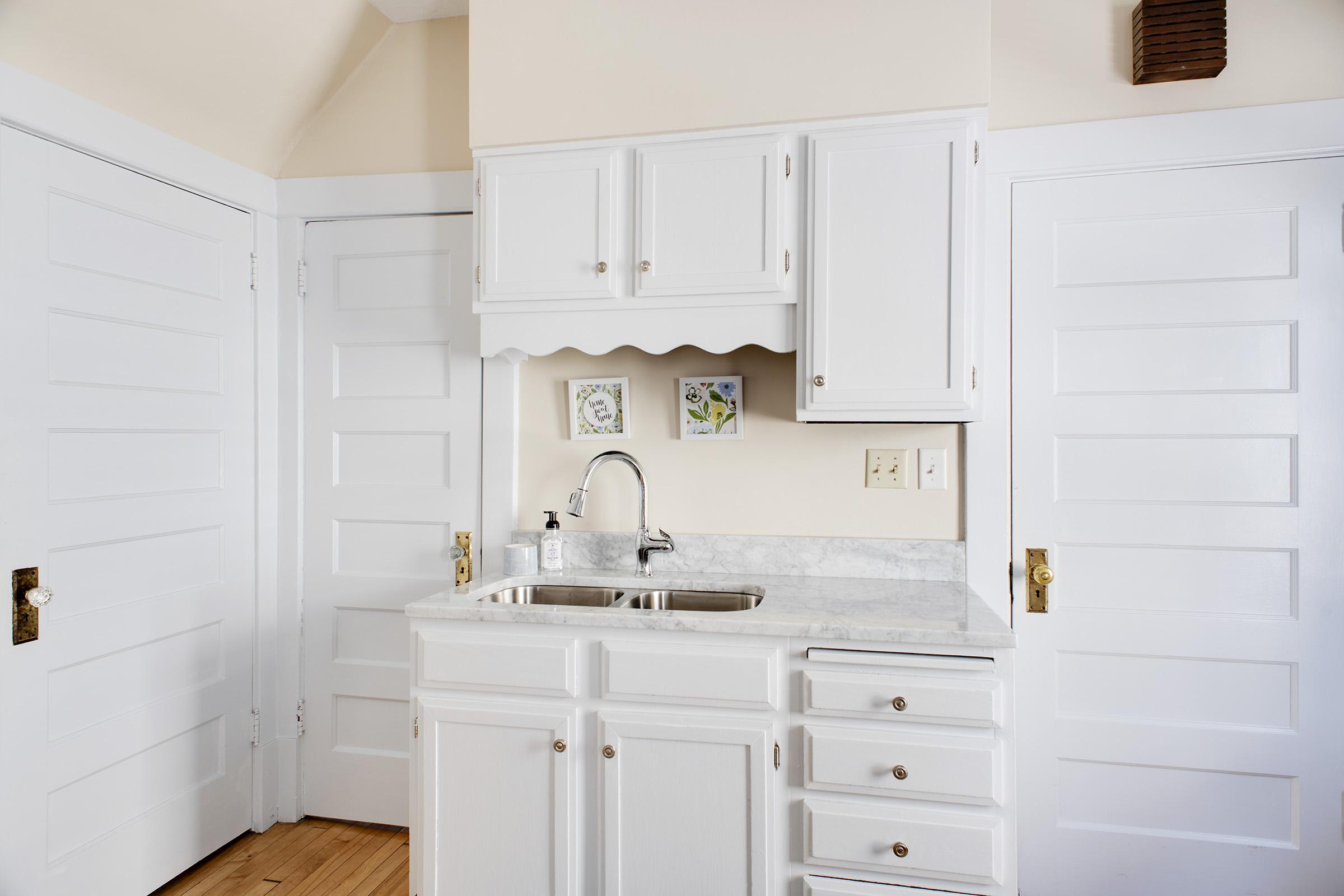 Kitchen [basement door, left, bathroom door, middle, door to backyard, right]