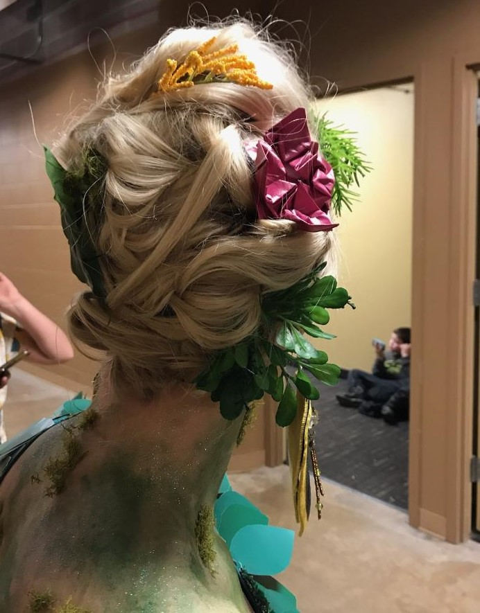 Hair and makeup provided by  Rocco Altobelli Salon and Day Spa . Like our mini origami lotus flower for hair ? :)