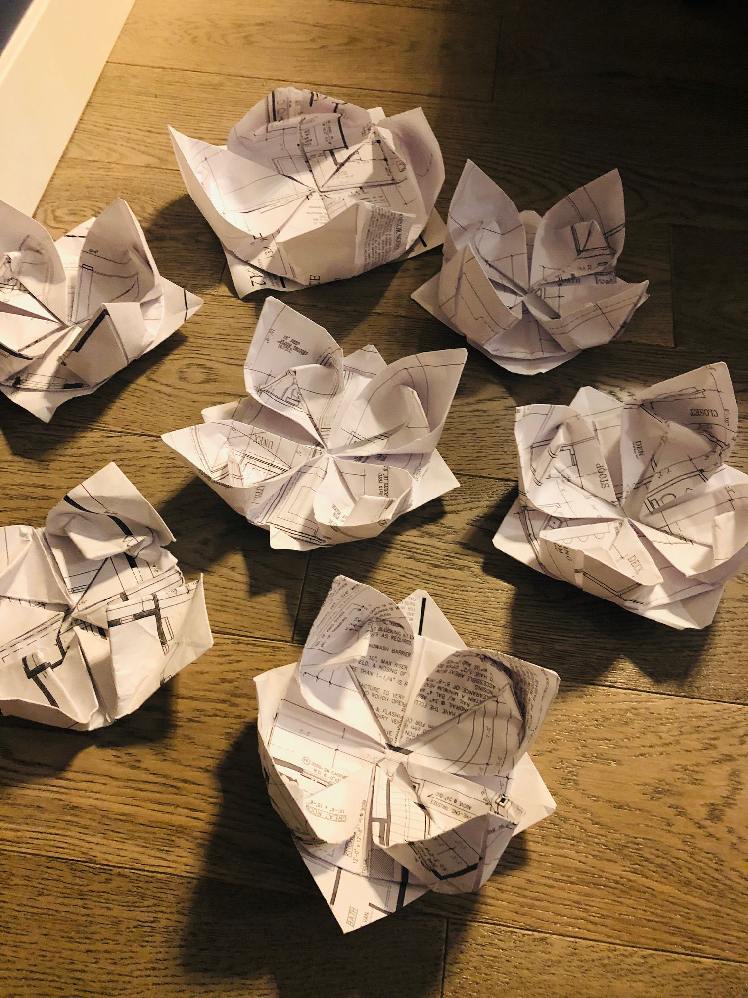 origami lotus flowers made from blueprints! :)