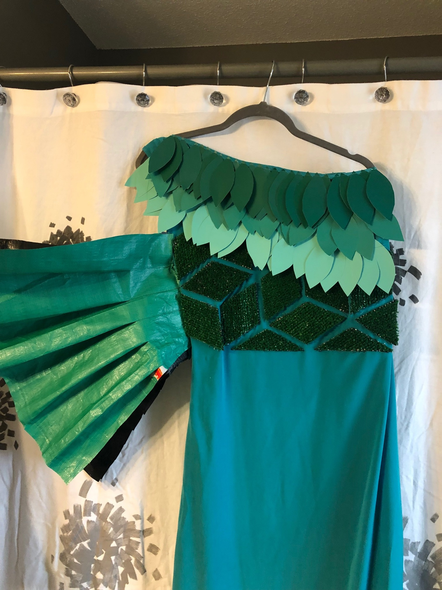 One ruffle sleeve was made from two pieces of accordion-folded green tarp.
