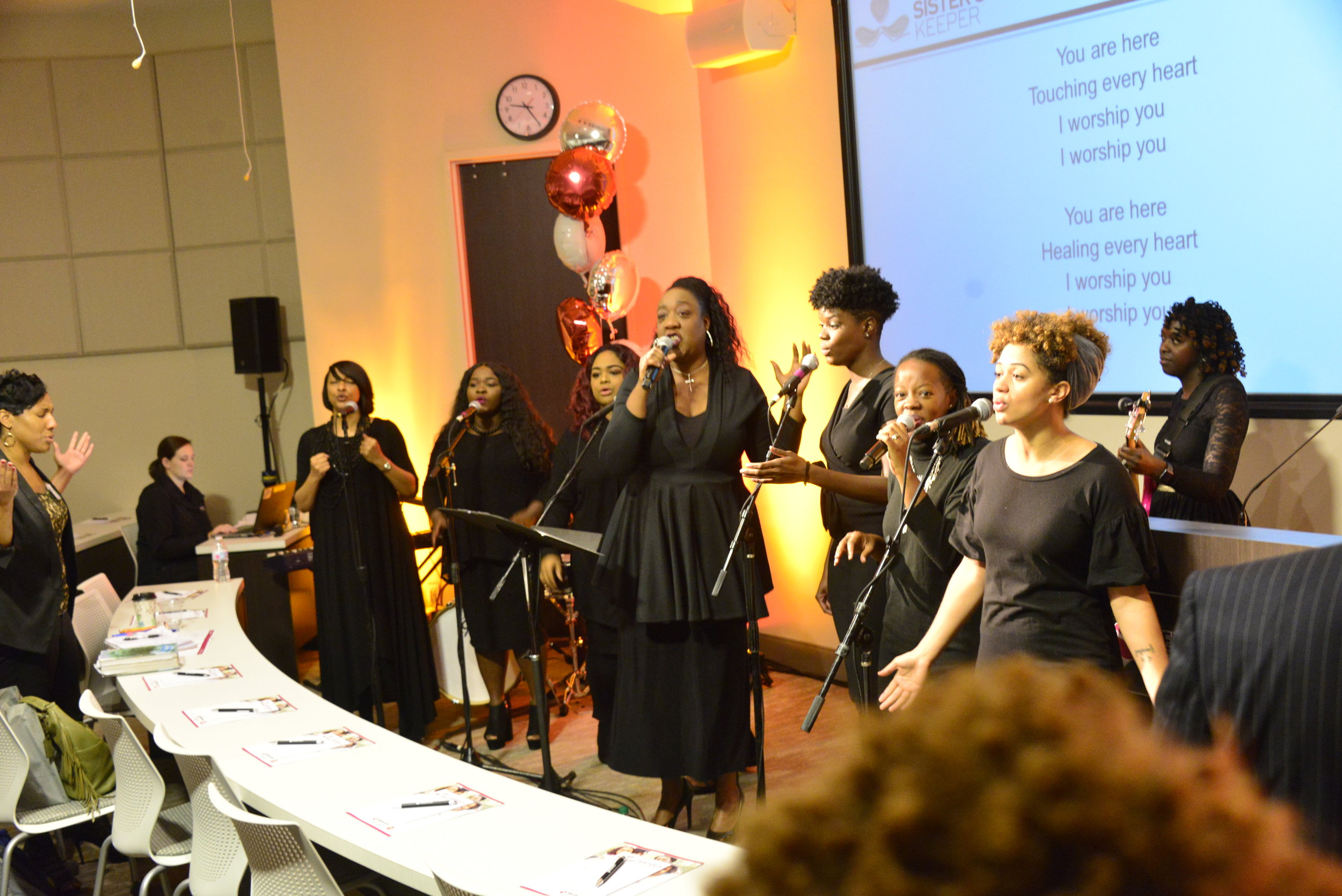 Ephie Johnson and the Praise and Worship Ministry lead music at the opening worship service.