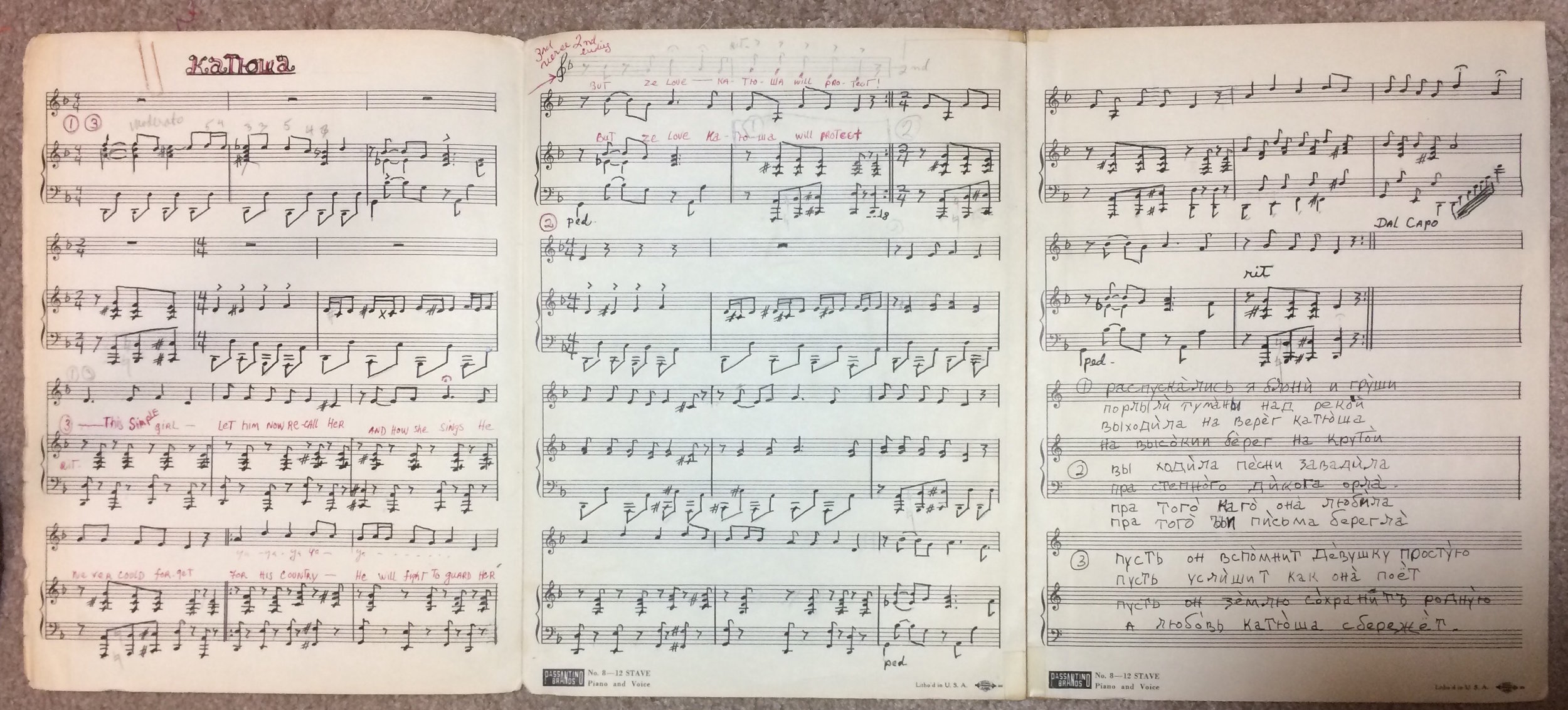 Salama's handwritten transcription of  Katyusha . You can hear Virginia playing this same piano arrangement in the recording for the quilt. Her handwriting is in red, writing a few english words out over the melody.